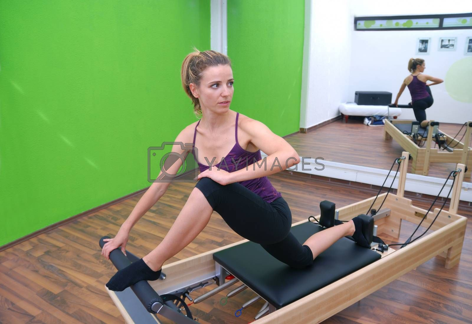pretty girl exercising in fitness studio
