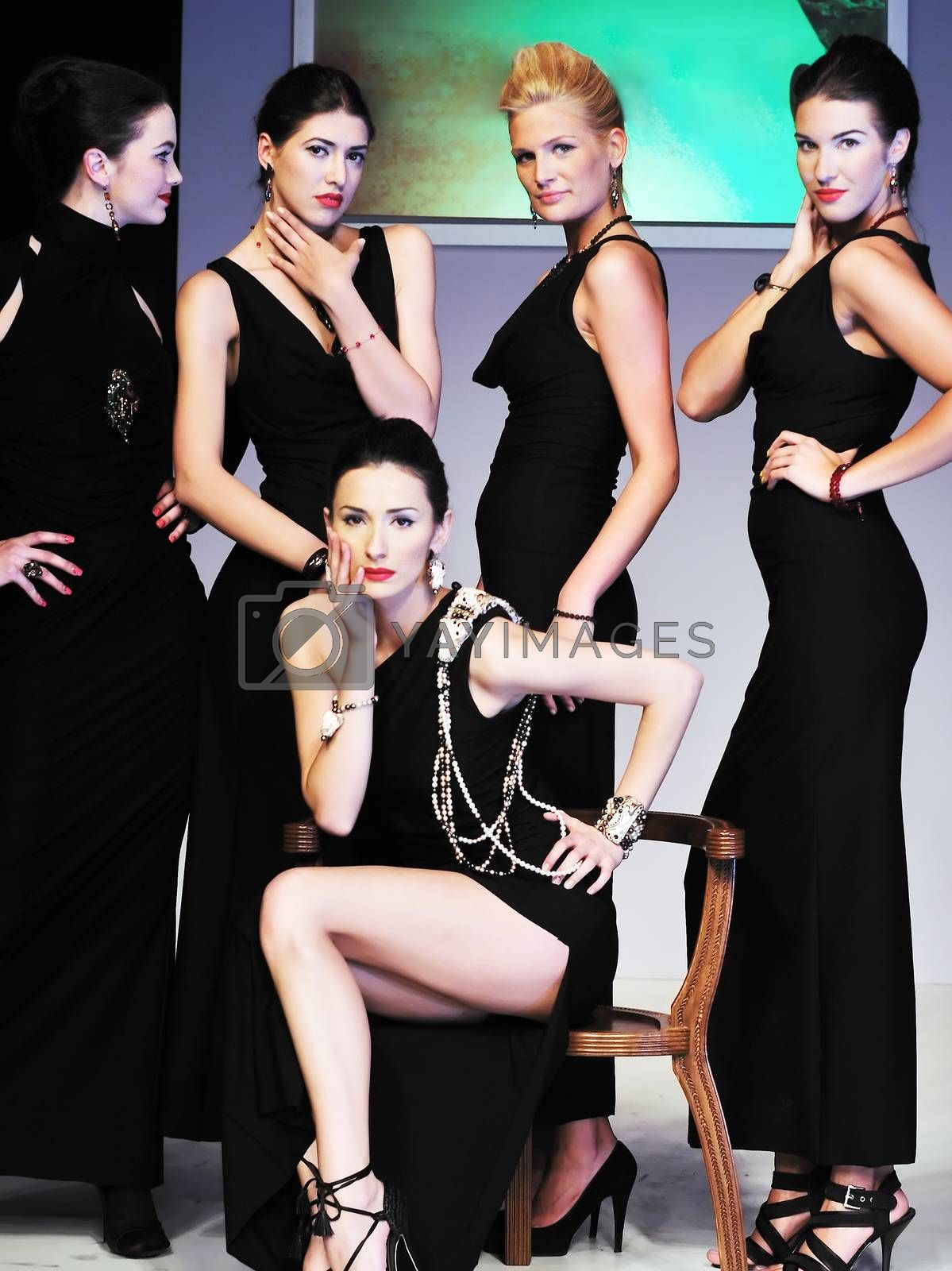 young models group posing on fashion show piste