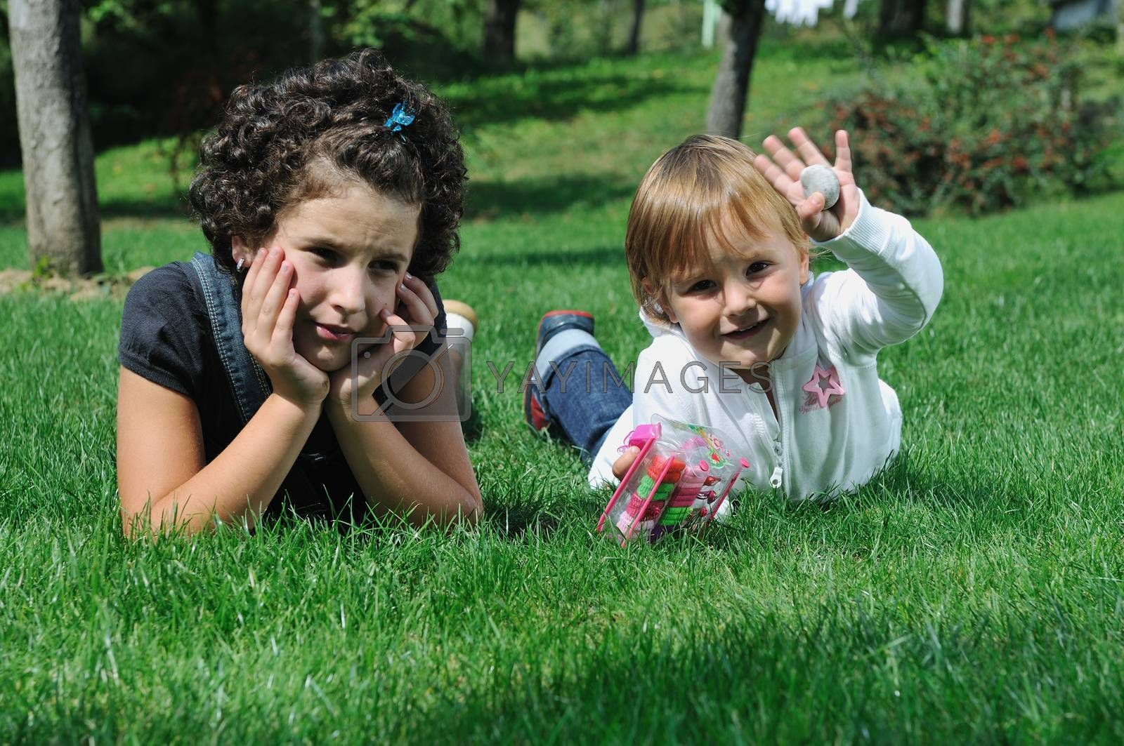child fashion with beautiful little child outdoor in nature