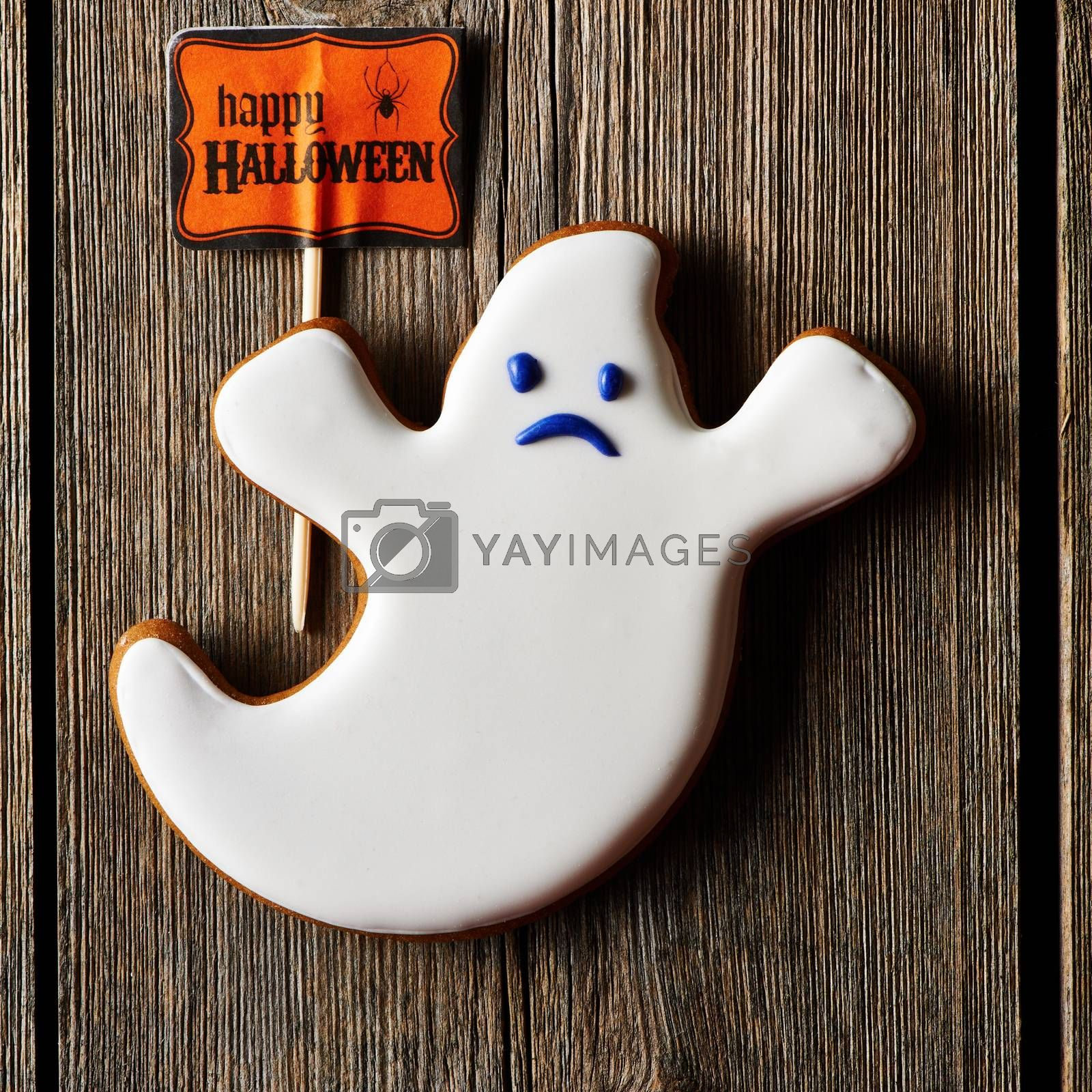 Halloween homemade gingerbread cookie over wooden table