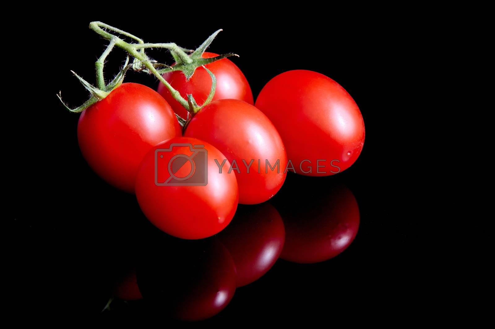 Tomatoes on black