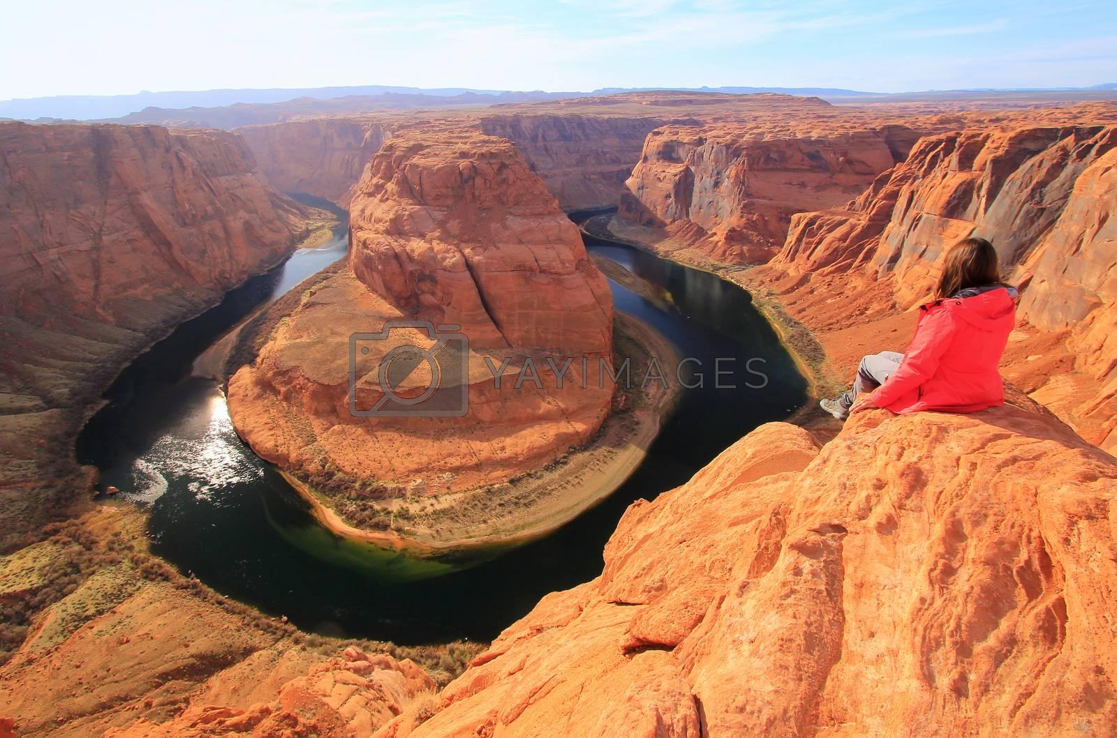 Royalty free image of Young woman enjoying view of Horseshoe bend, Arizona, USA by donya_nedomam