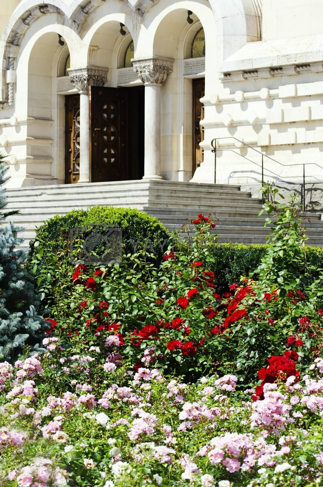 Decorative Garden With Flowers and Old Building