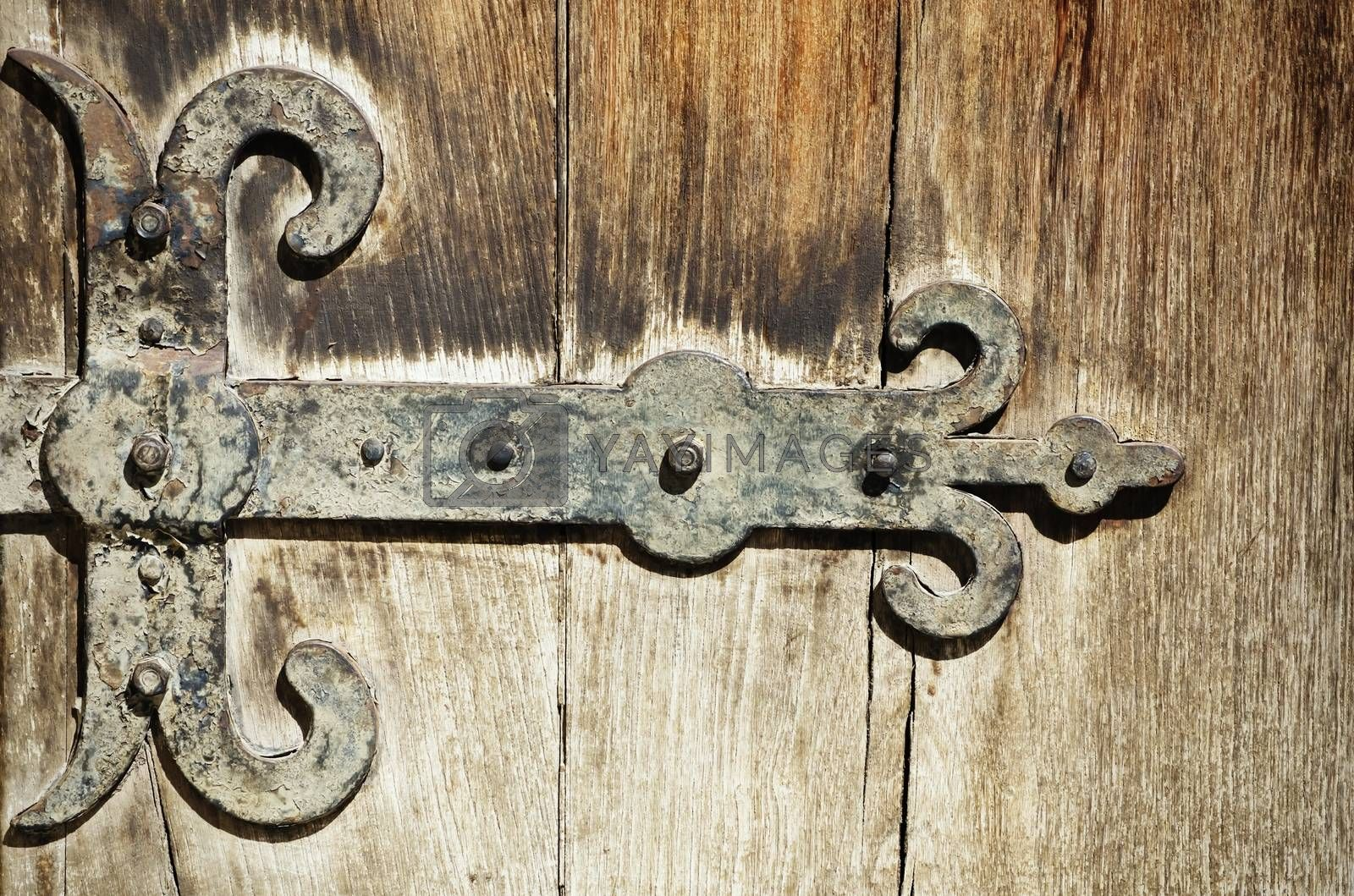 Photo of The Vintage Door Hinges Over Old Wooden Background