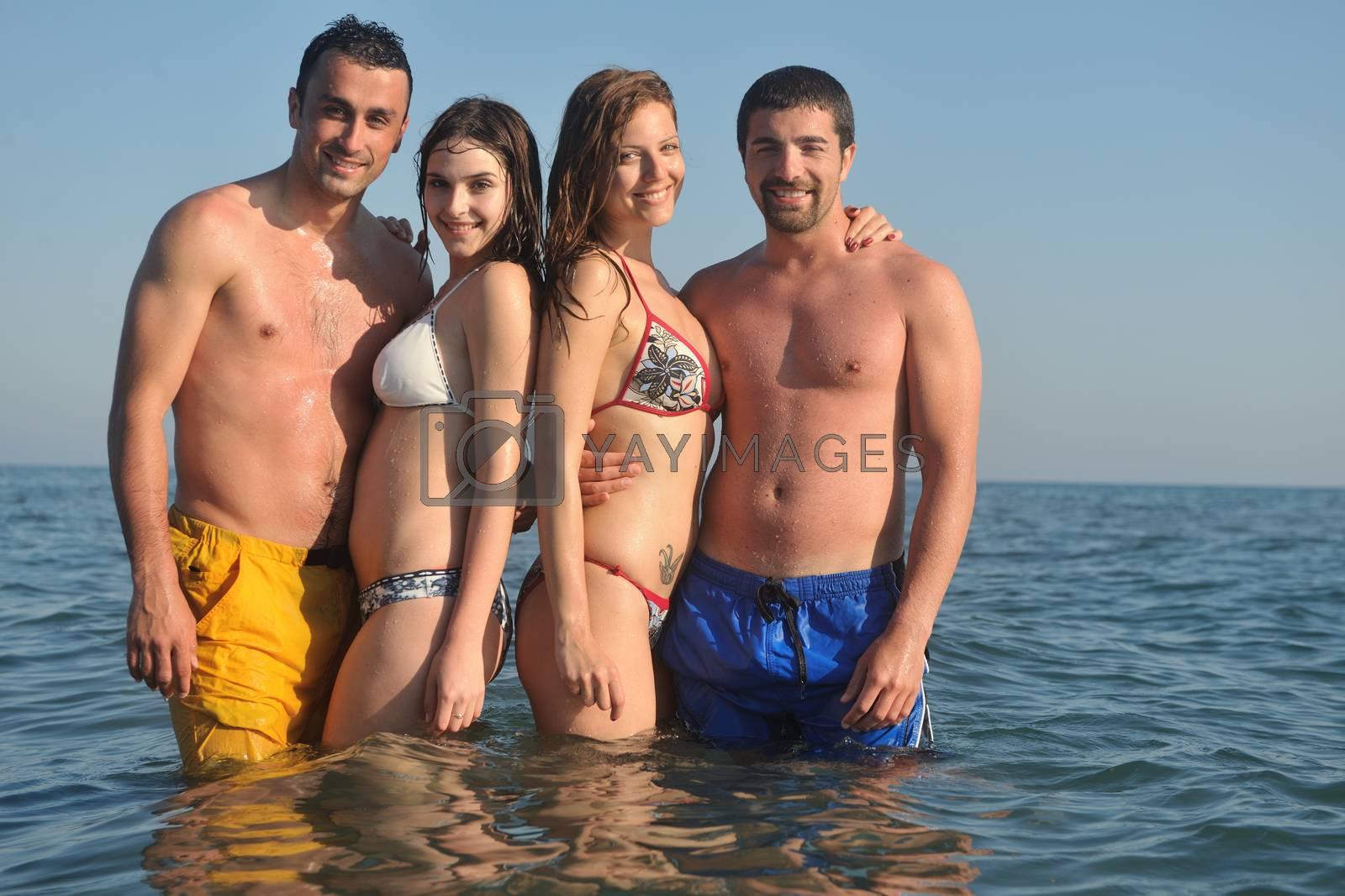 happy people group have fun  run and jump  on beach beautiful sand  beach