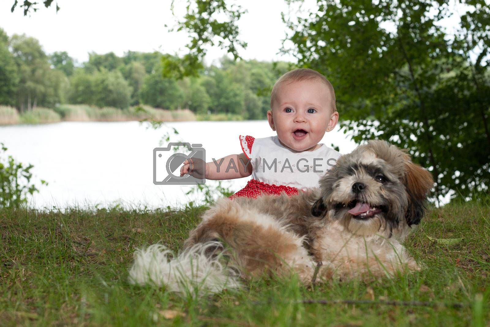 Happy baby and puppy near the lake by DNFStyle