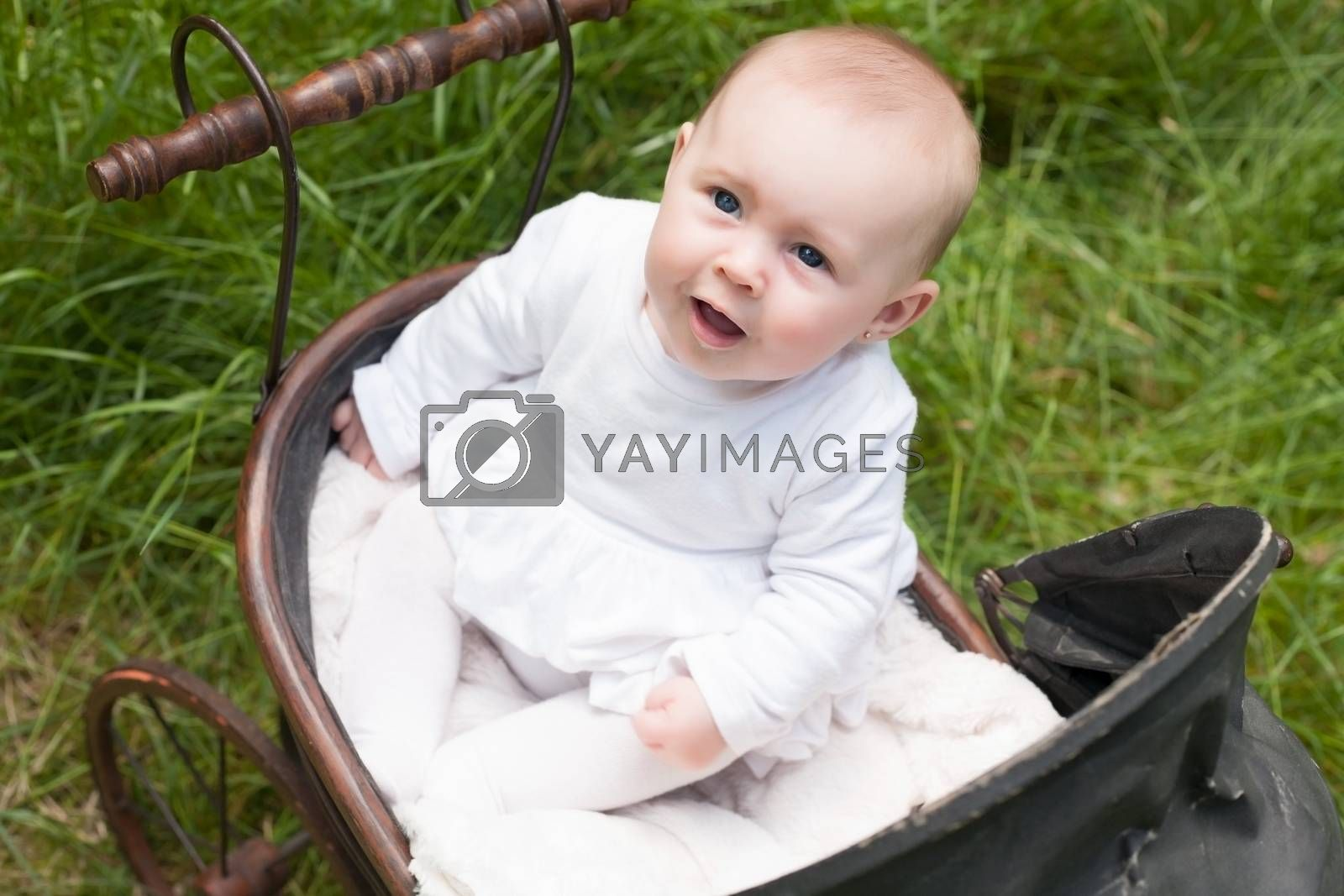 Baby is looking up in her pram by DNFStyle