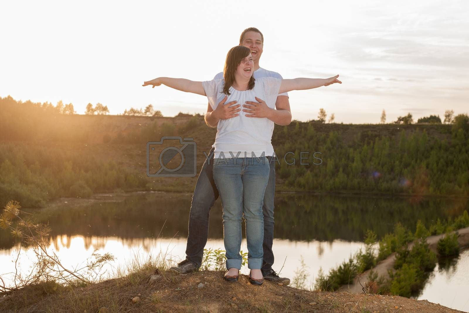 Young couple is having a romantic time in nature
