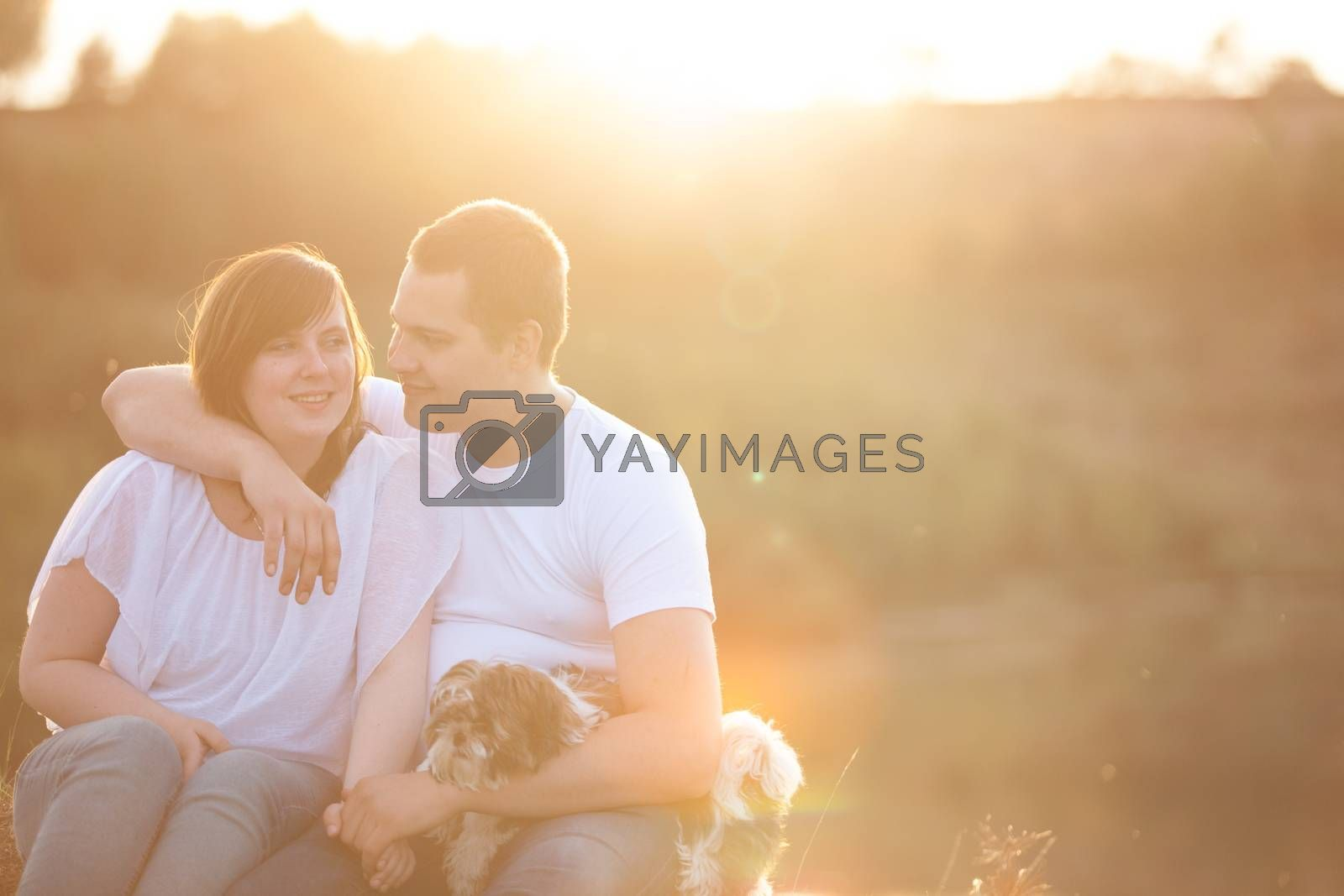 Young couple and puppy in sunlight by DNFStyle
