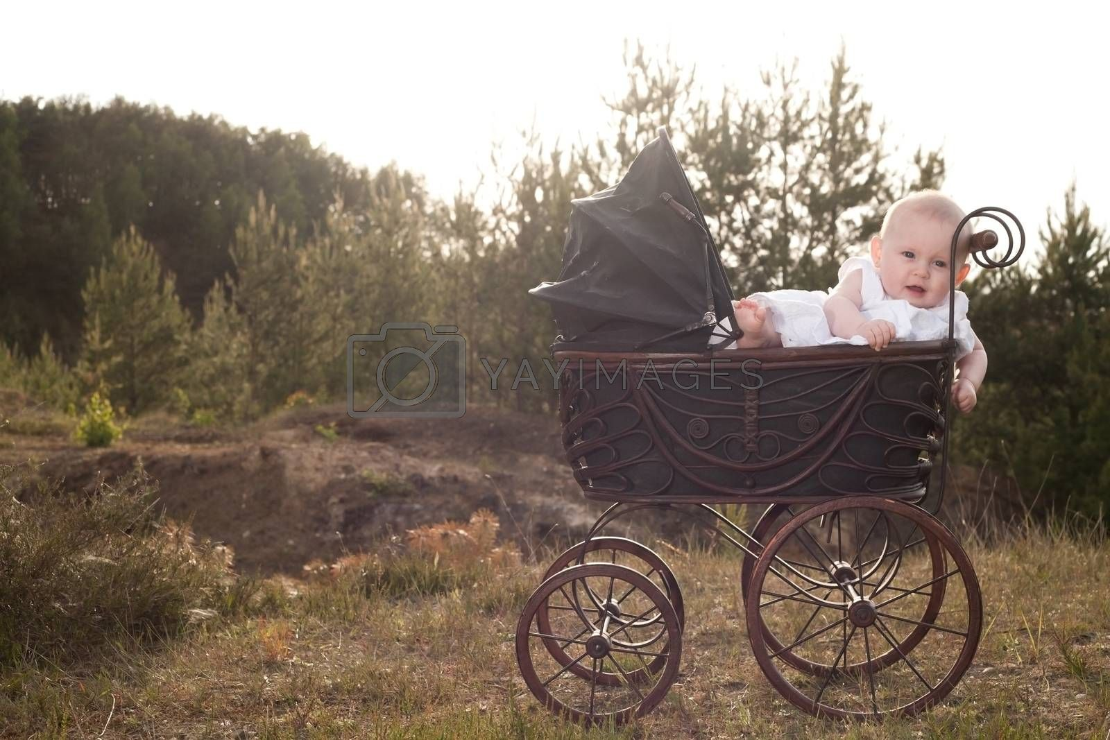 Baby in pram with sunset by DNFStyle