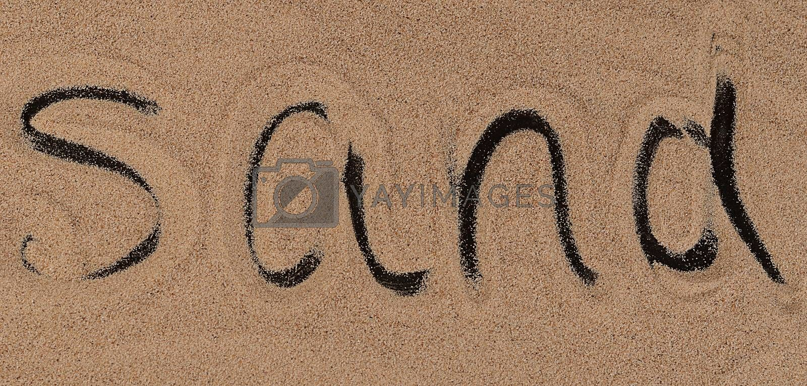 The sand on the black background close-up