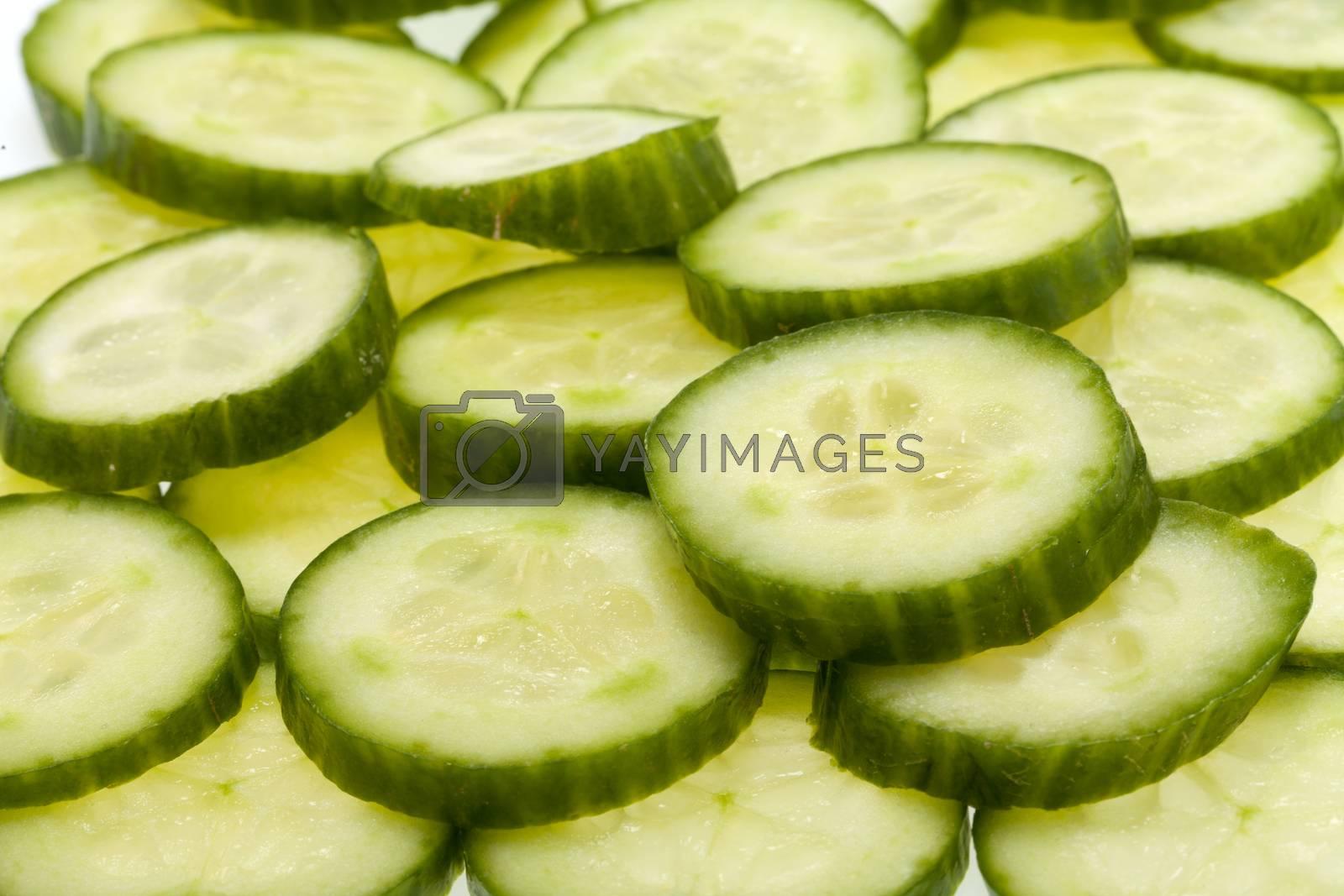 Freshly sliced cucumber  isolated on white background