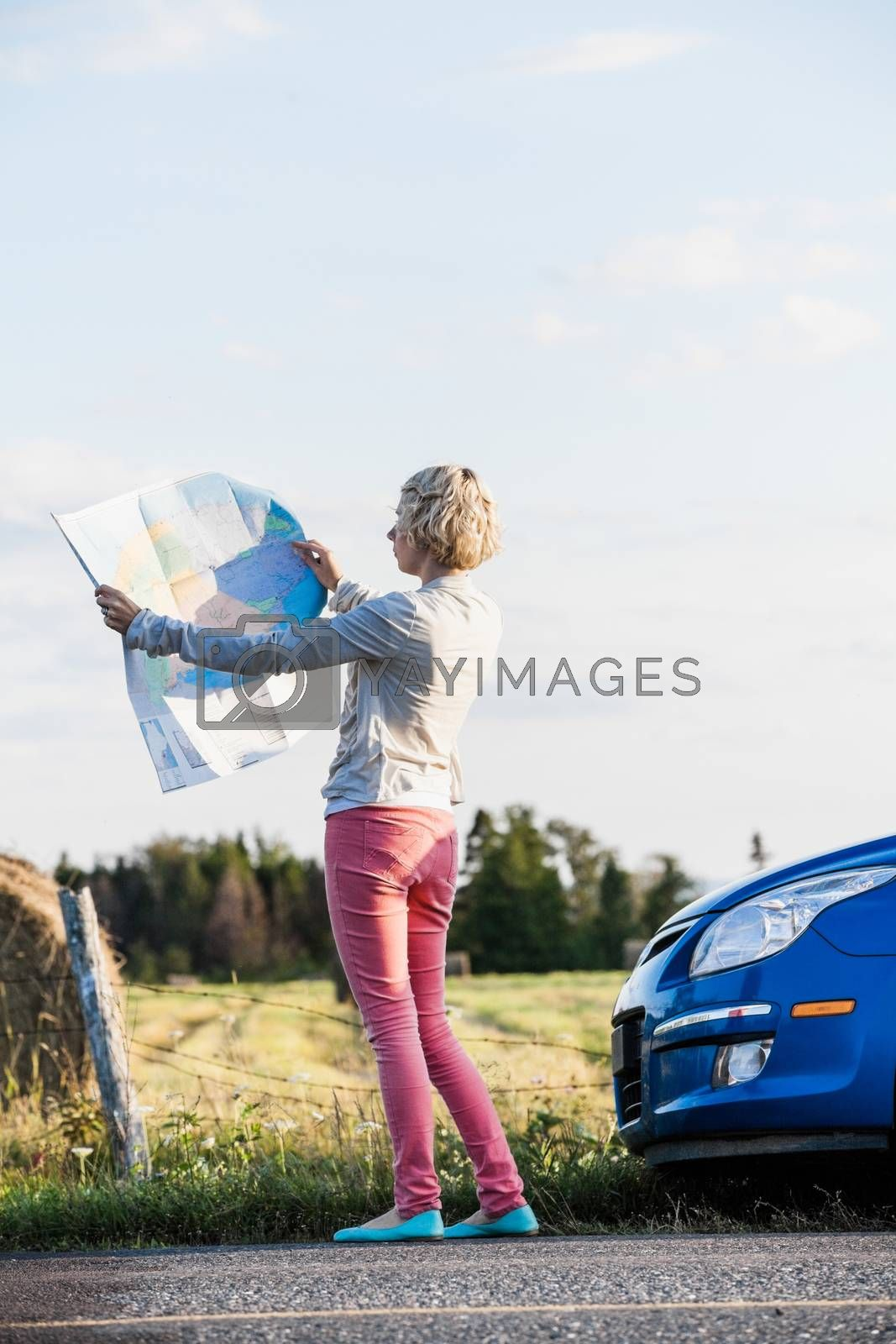 Lost Woman on a Rural Scene Looking at a Map