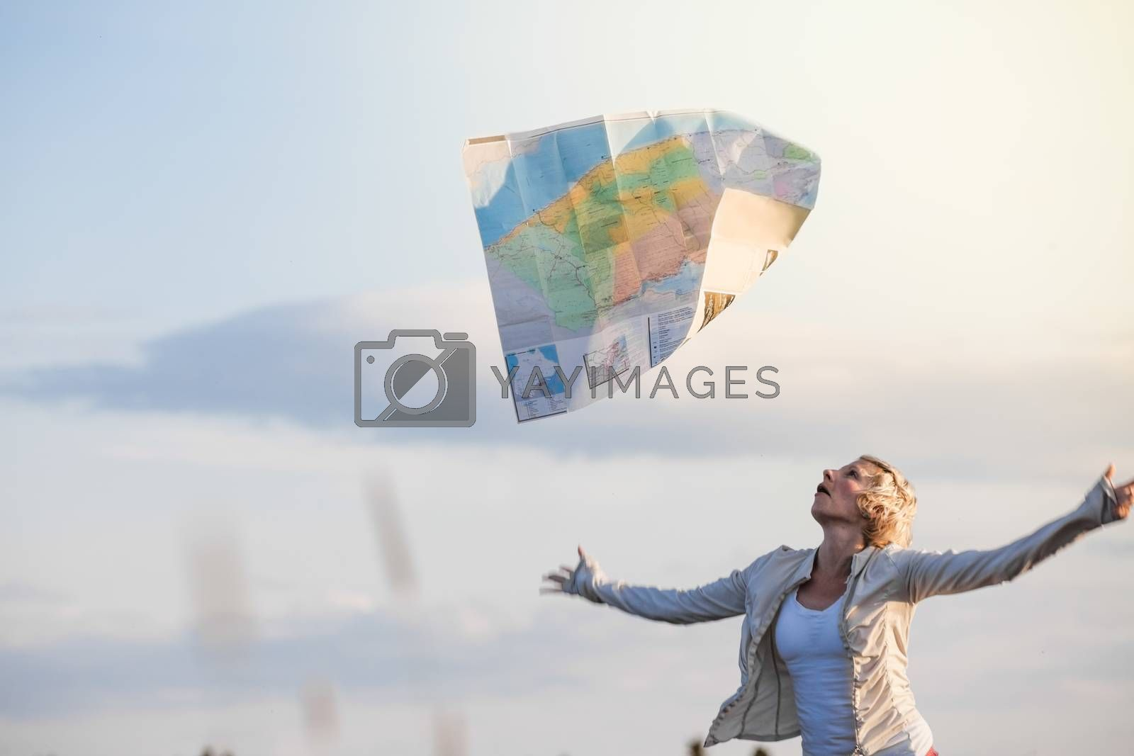 Funny Photo of a Young Lost Woman Losing a Map Bacause of the Wind