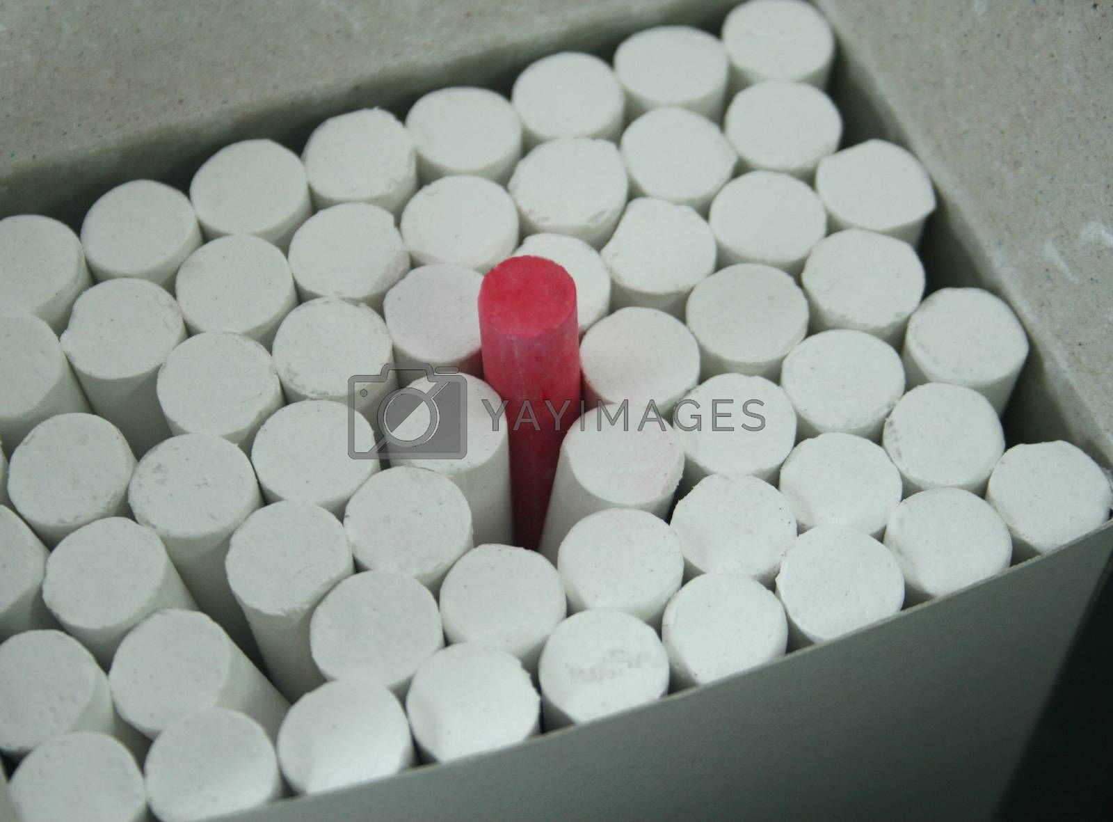 Photo of White chalks with red in a box