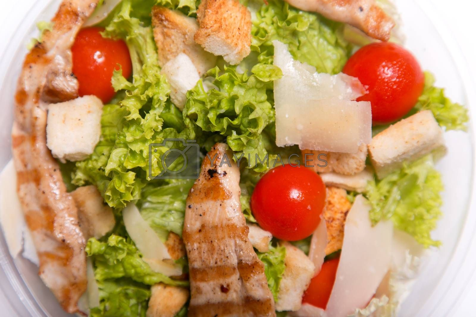 Delicious Caesar salad with grilled chicken meat, top view