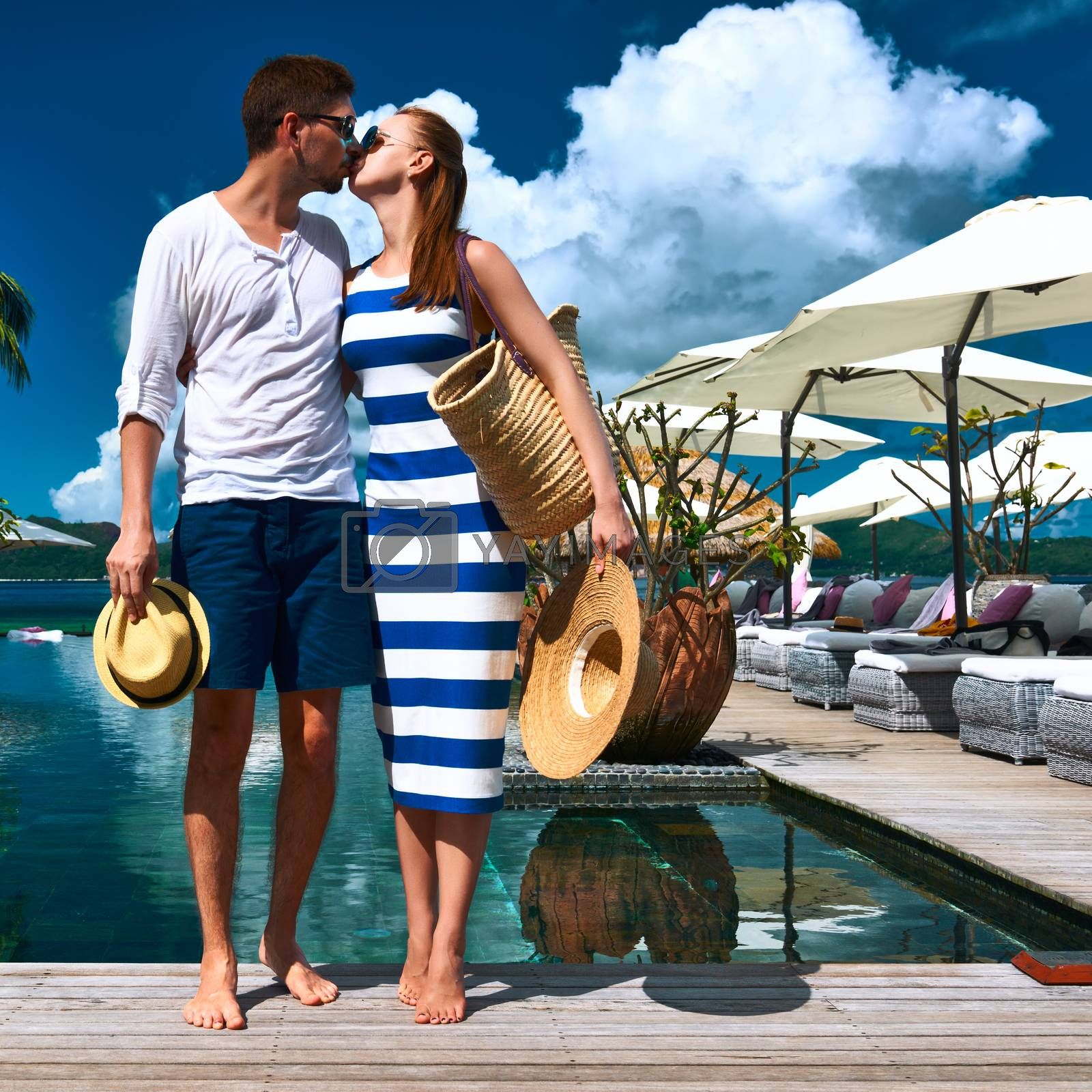 Couple kissing near poolside jetty at Seychelles