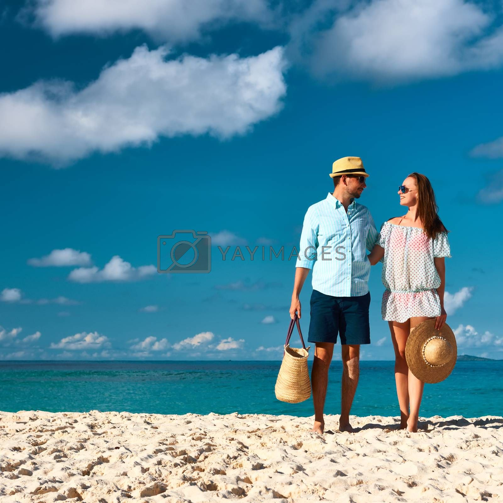 Couple on a beach at Seychelles by haveseen