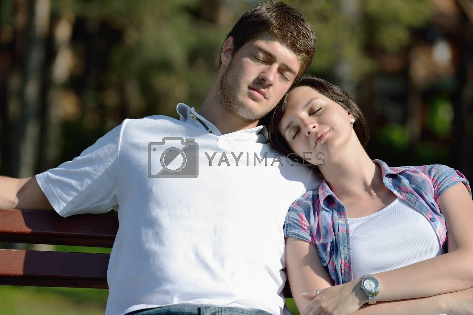 Portrait of romantic young couple in love  smiling together outdoor in nature with blue sky in background