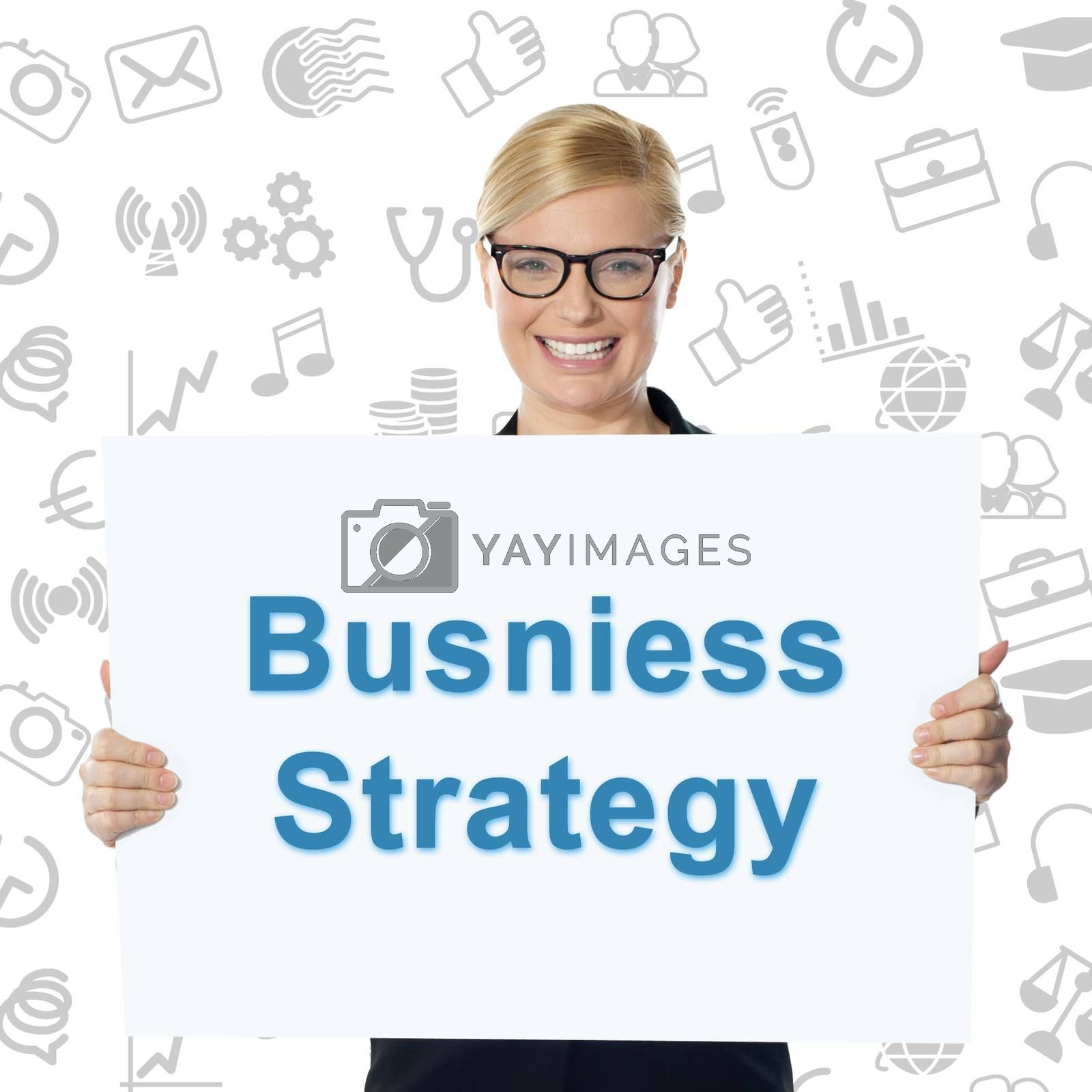 Smiling businesswoman holding business strategy banner