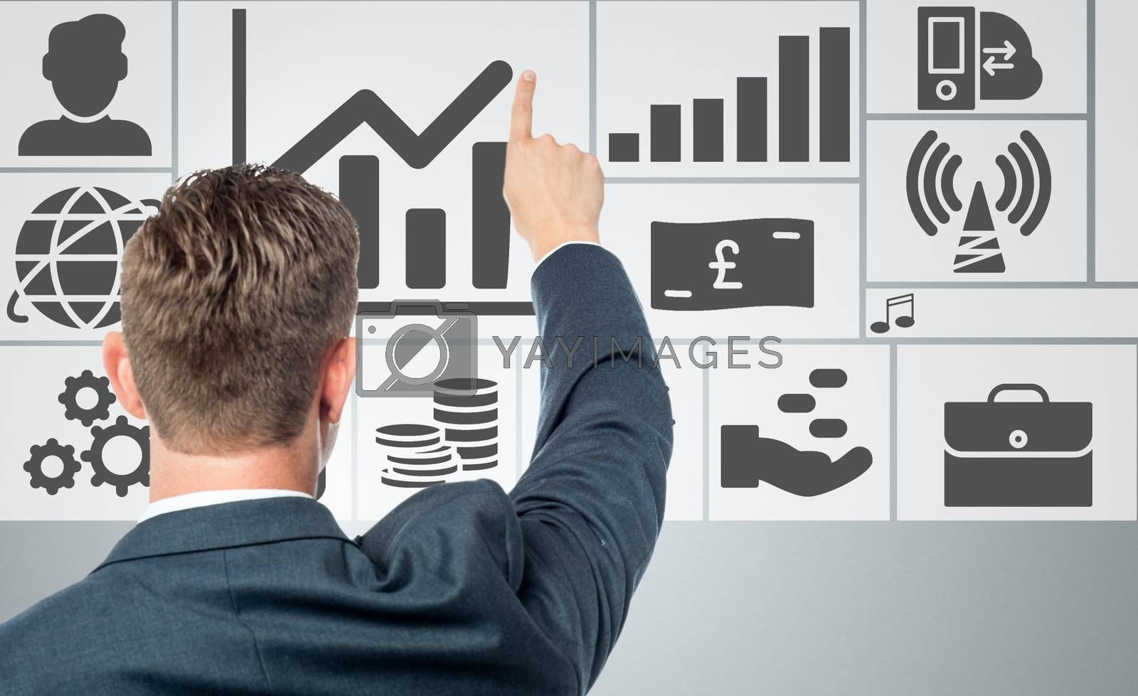 Successful businessman with business icons by stockyimages