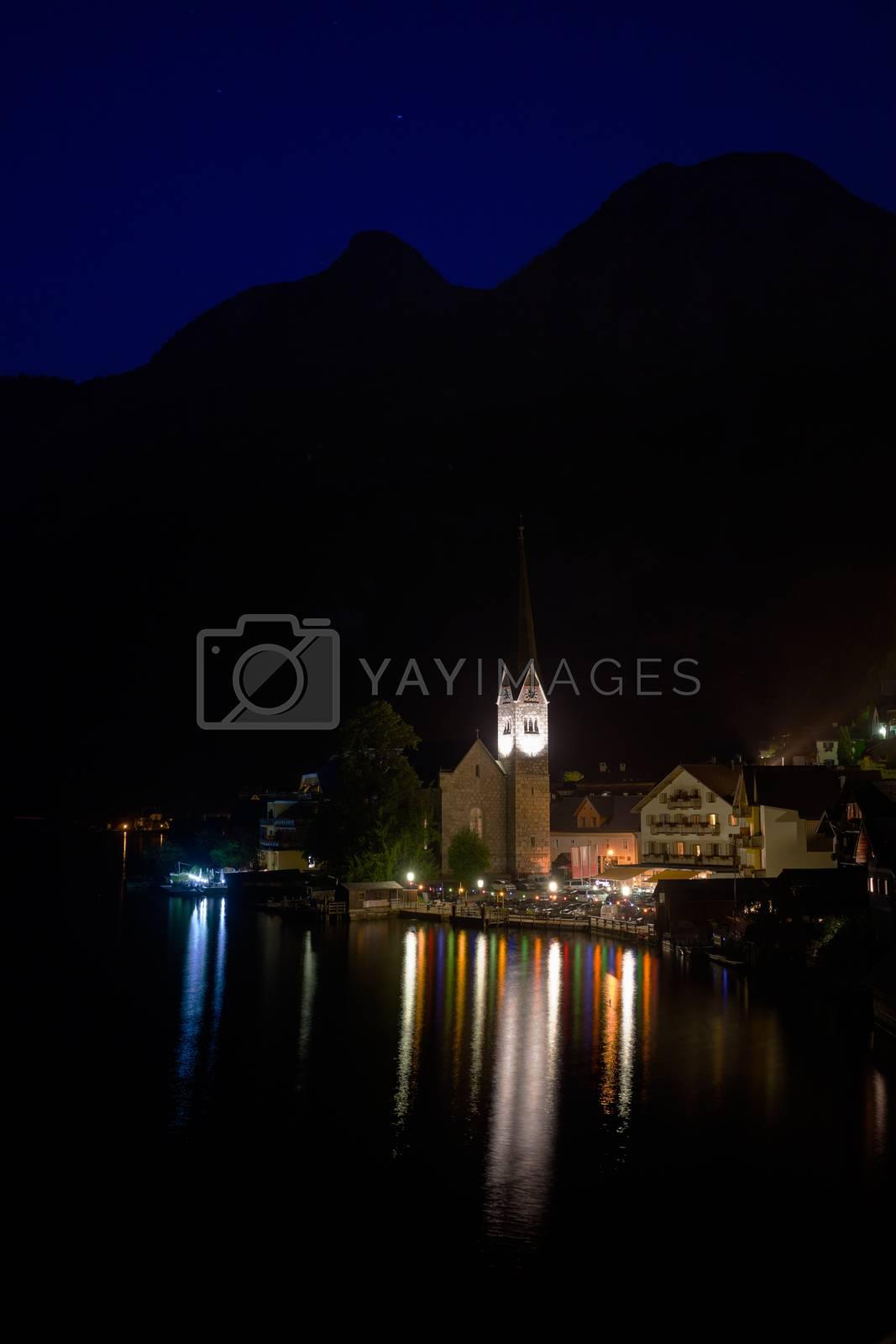Night view of Hallstatt village by PixAchi