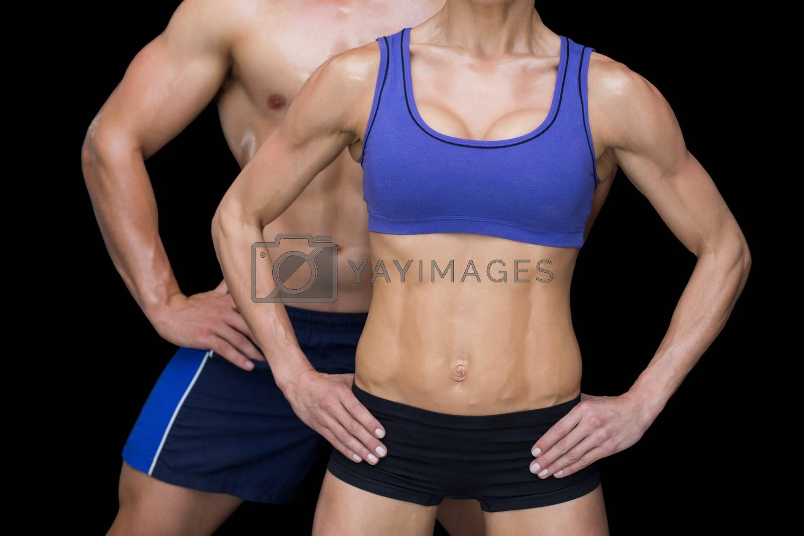 Royalty free image of Crossfit couple posing with hands on hips by Wavebreakmedia