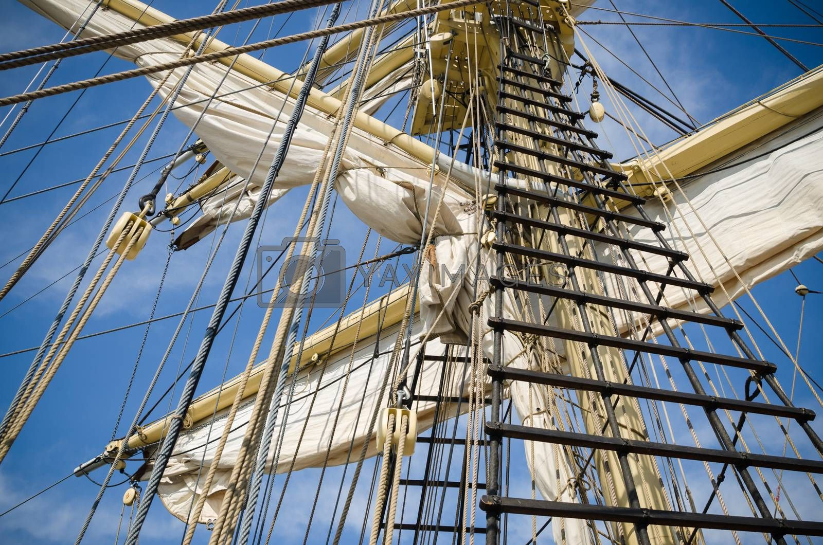 Royalty free image of Sails and tackles of a sailing vessel on a background of the sky by breeze09
