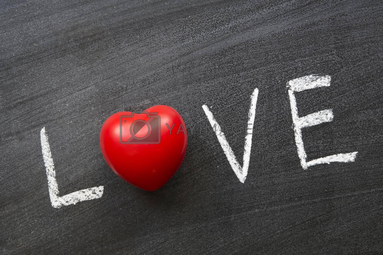 love word handwritten on blackboard with red heart instead of o
