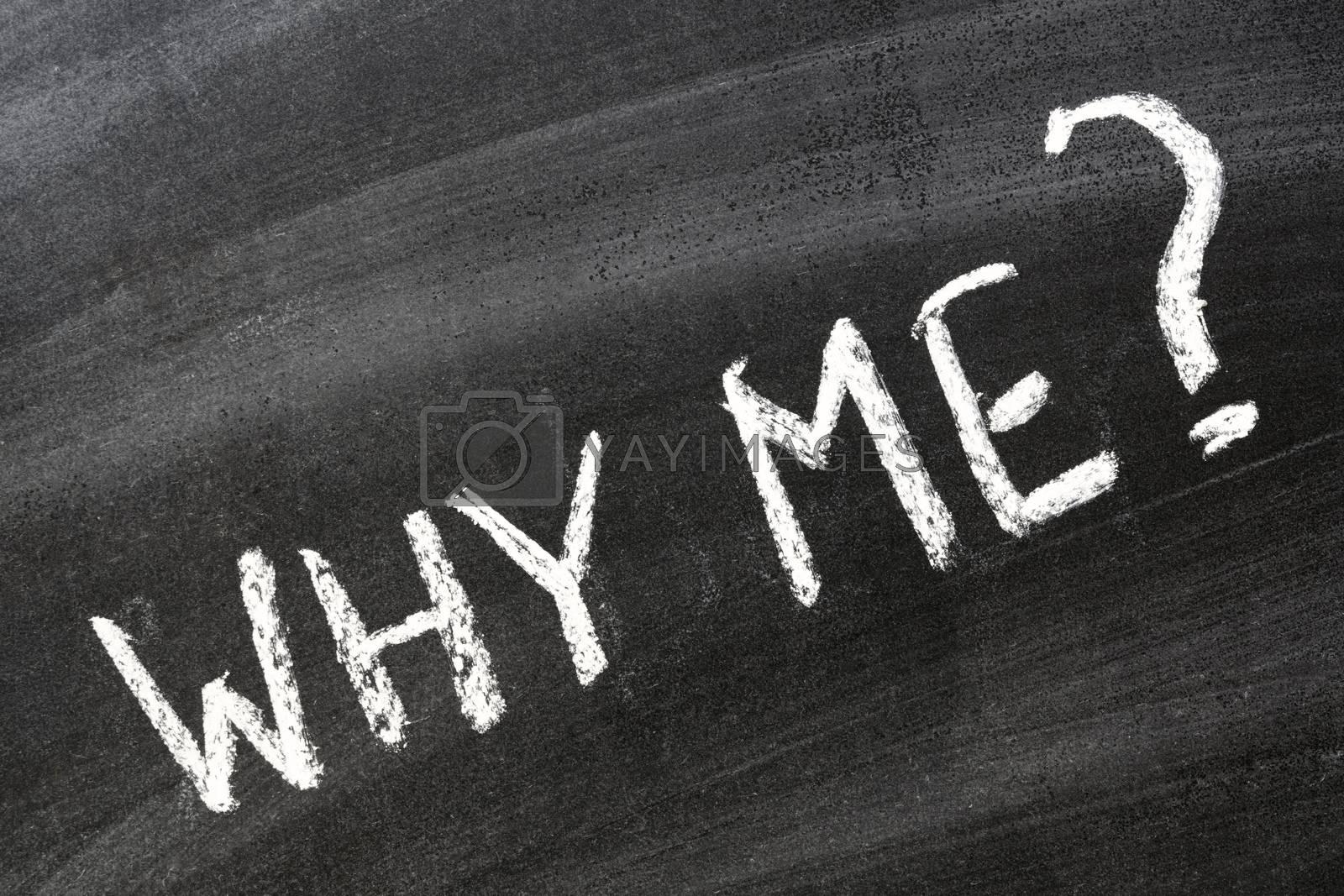 Why me? Question handwritten on school blackboard