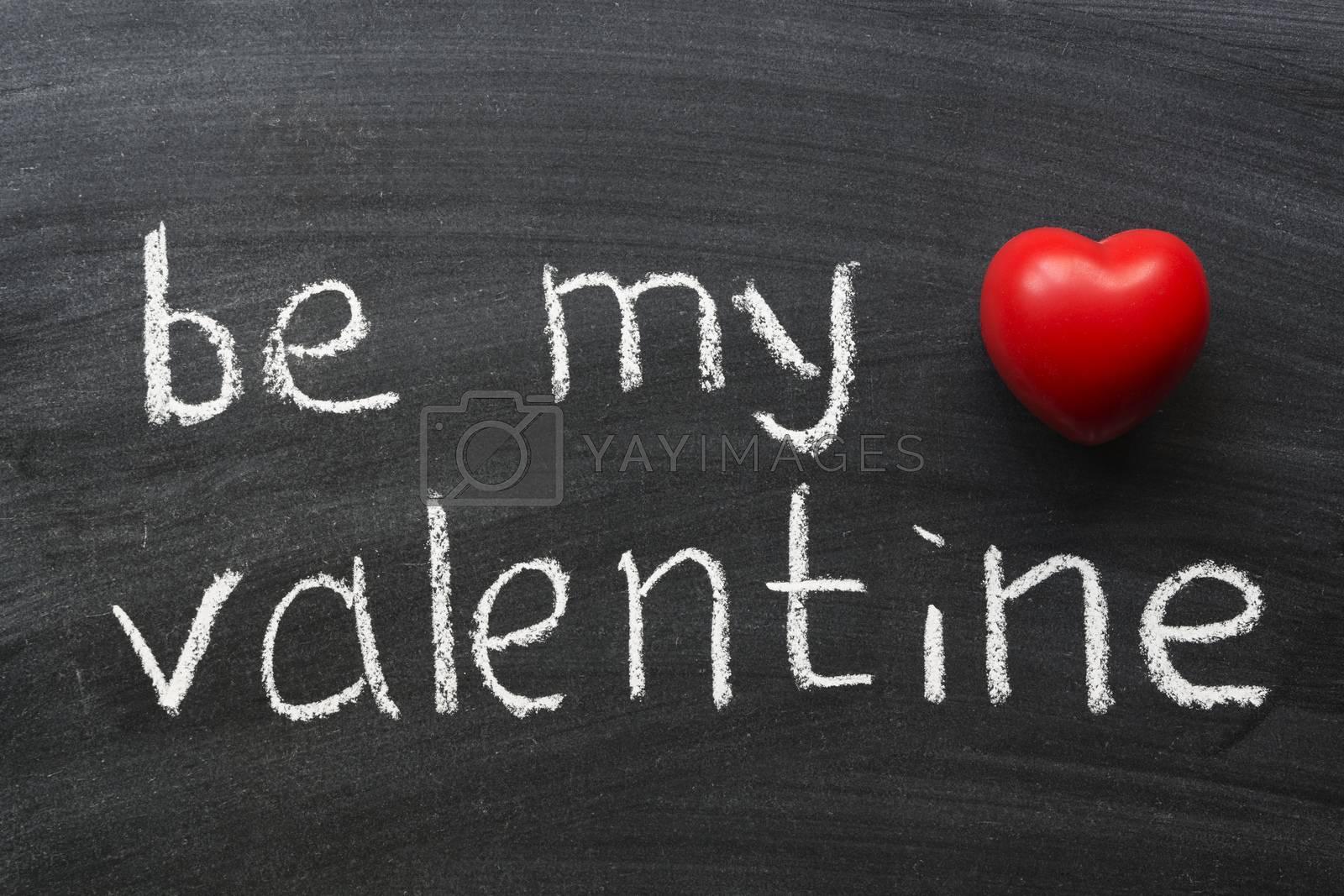 be my valentine phrase handwritten on school blackboard