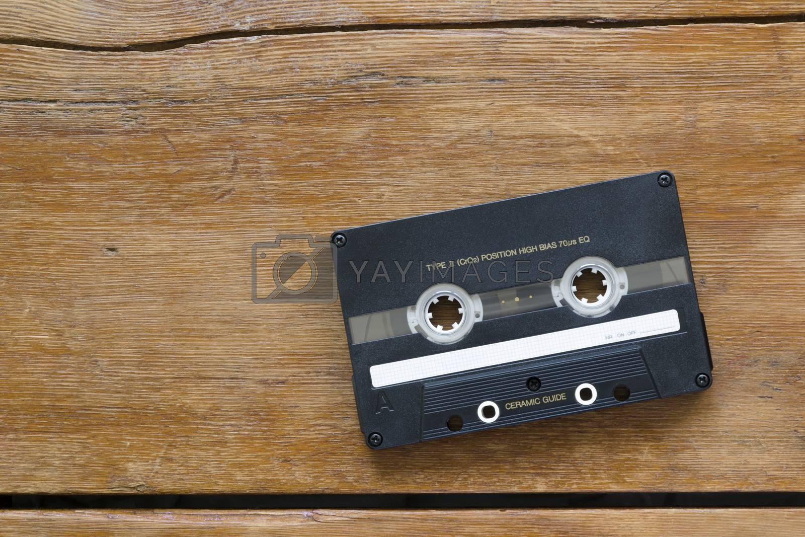 vintage hi-end audio cassette on cracked wooden table