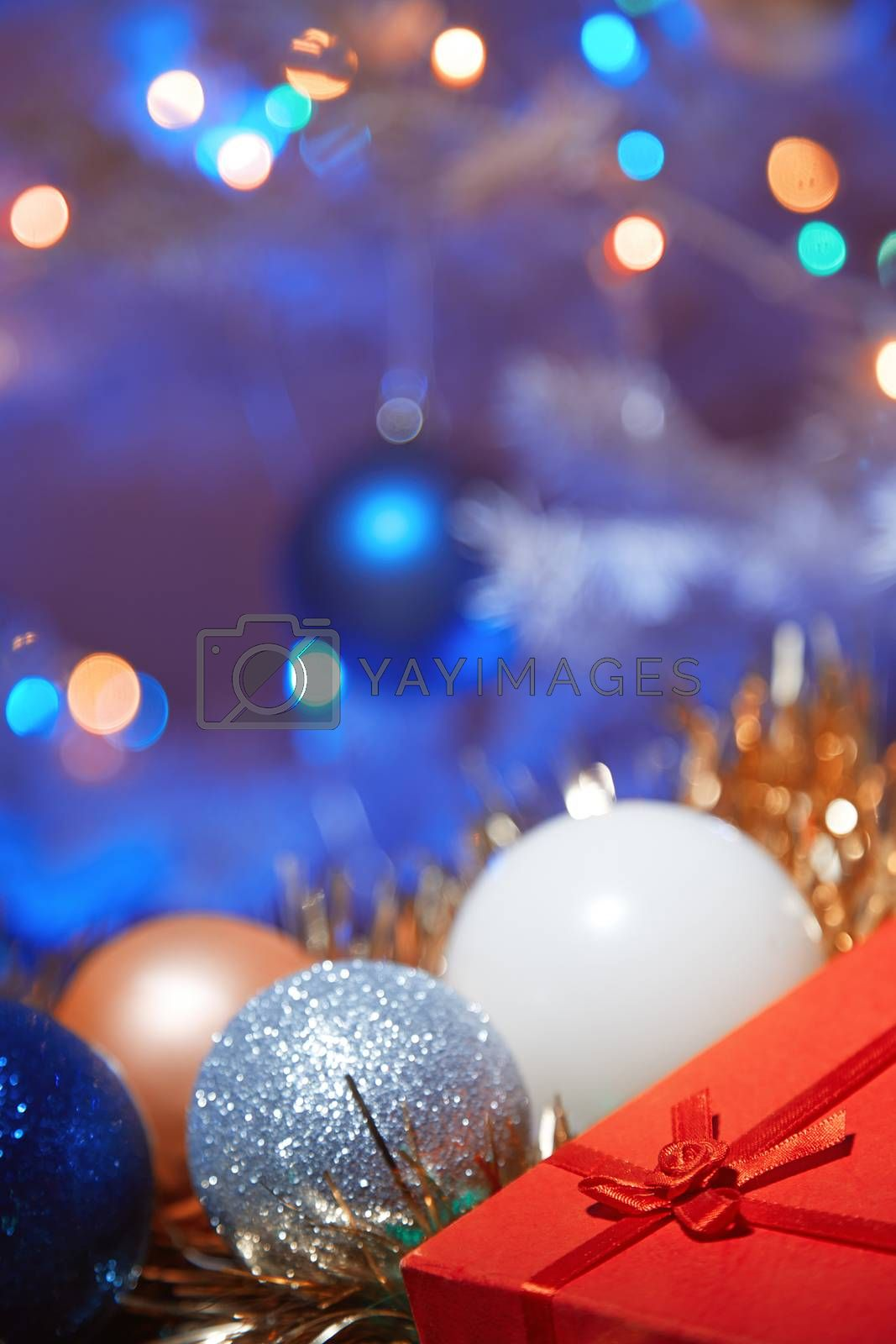 Close-up view on the Christmas decoration and gift box. Vertical photo
