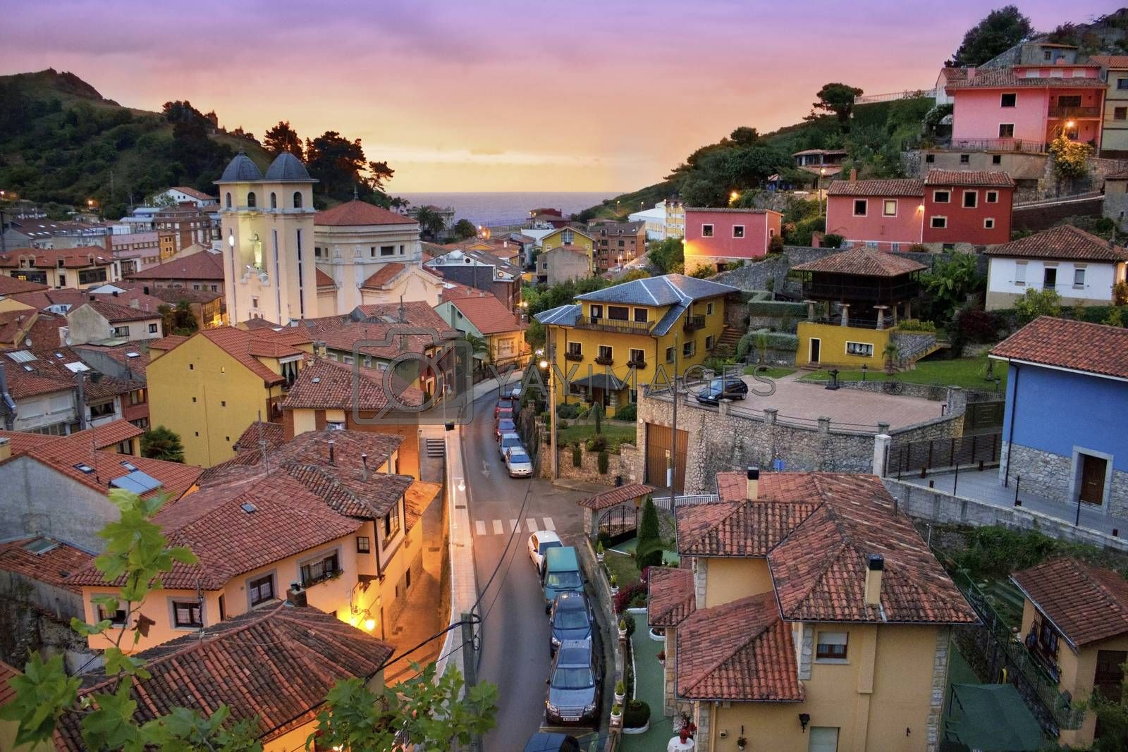 Little village of Asturias, Spain, next to the sea. This photography show the sunset in this beautiful landscape, with beautiful and colorful houses.