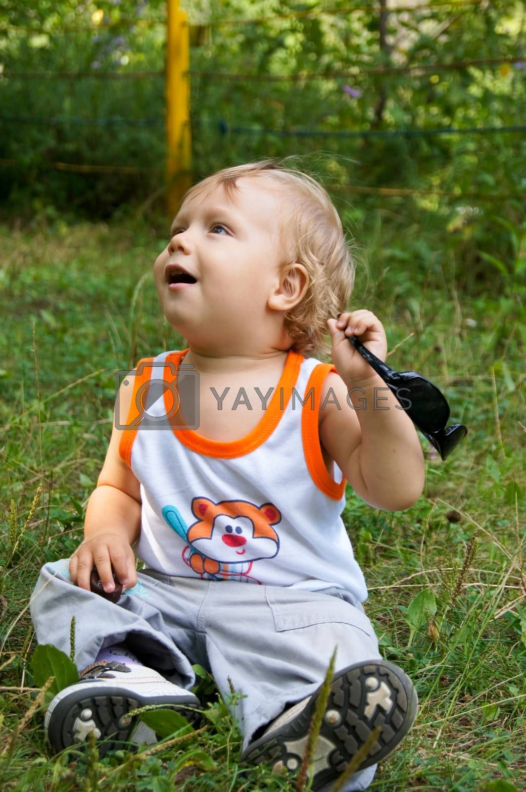 The amusing little boy on walk