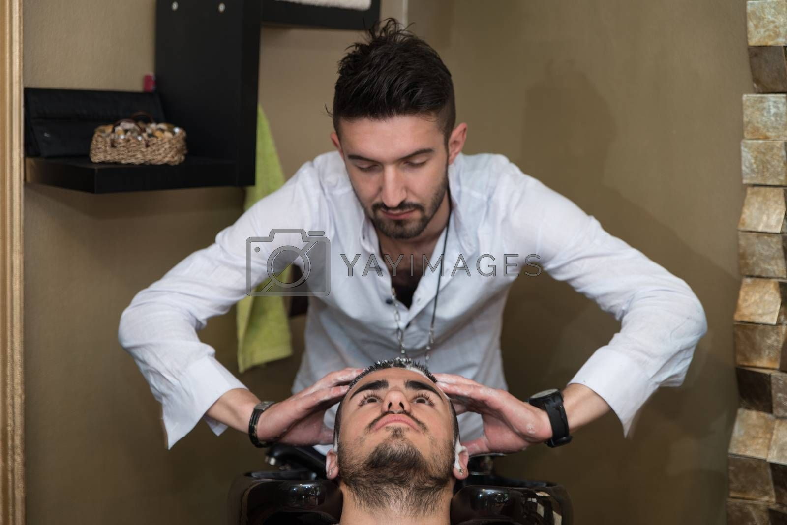 Hairstylist Hairdresser Washing Customer Hair - Young Man Relaxing In Hairdressing Beauty Salon