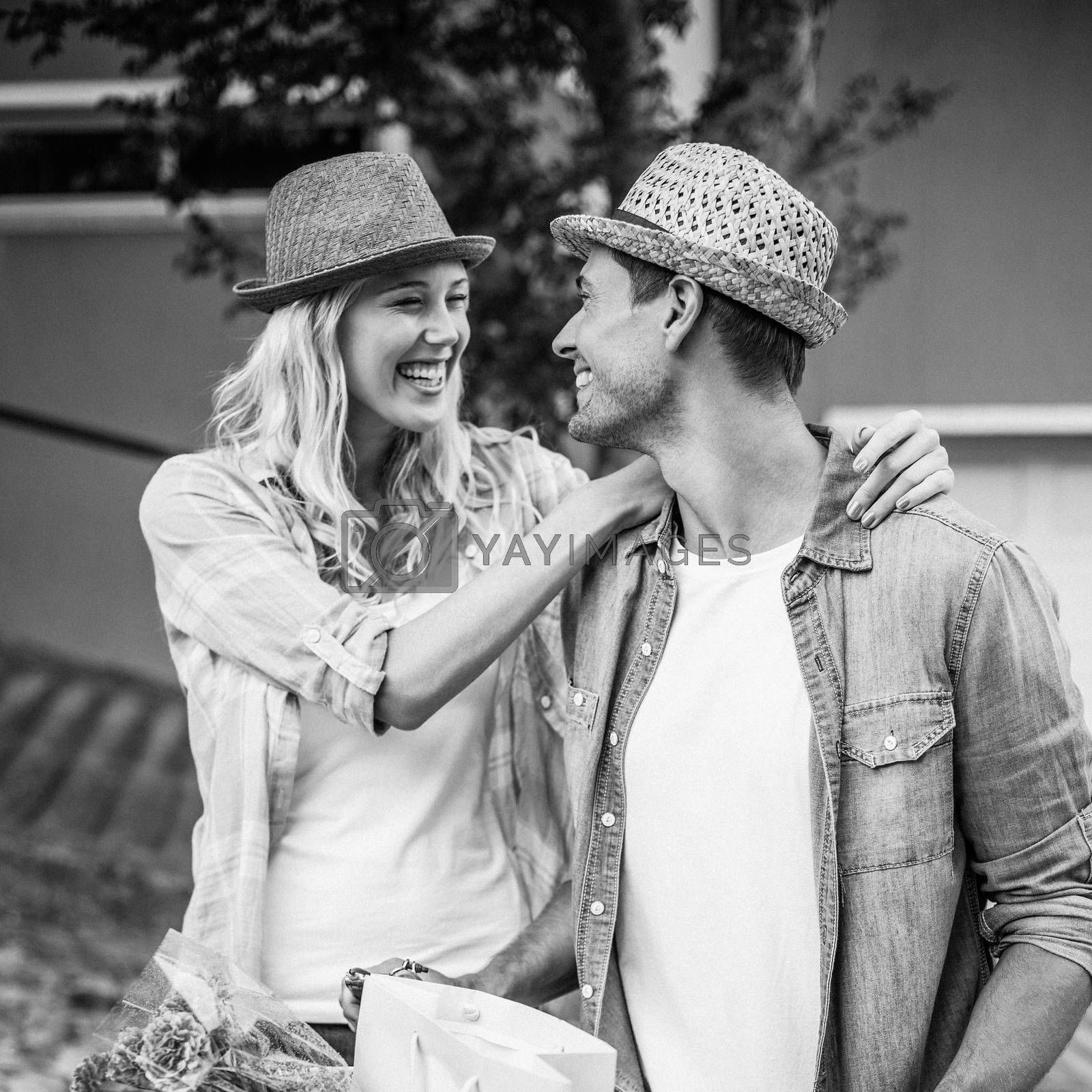 Hip young couple going for a bike ride in black and white
