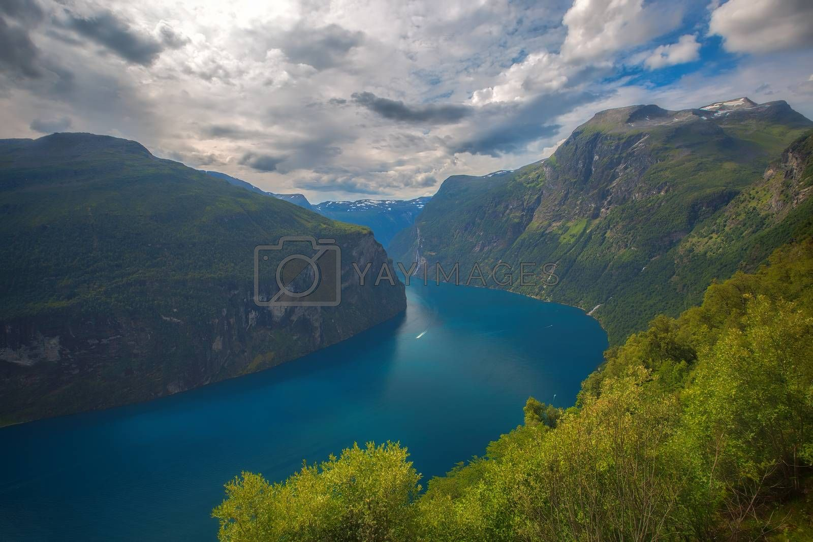 The Geiranger fjord in Norway, surrounded by high mountains