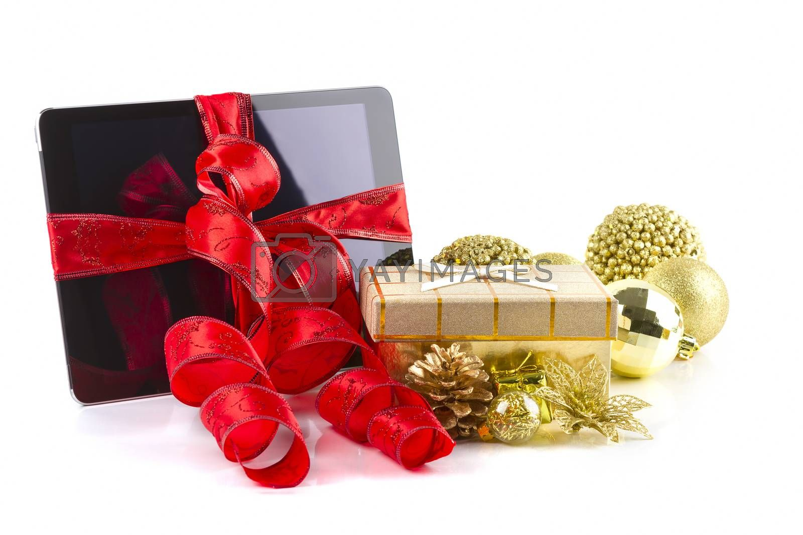 tablet pc with  christmas decorations on white background