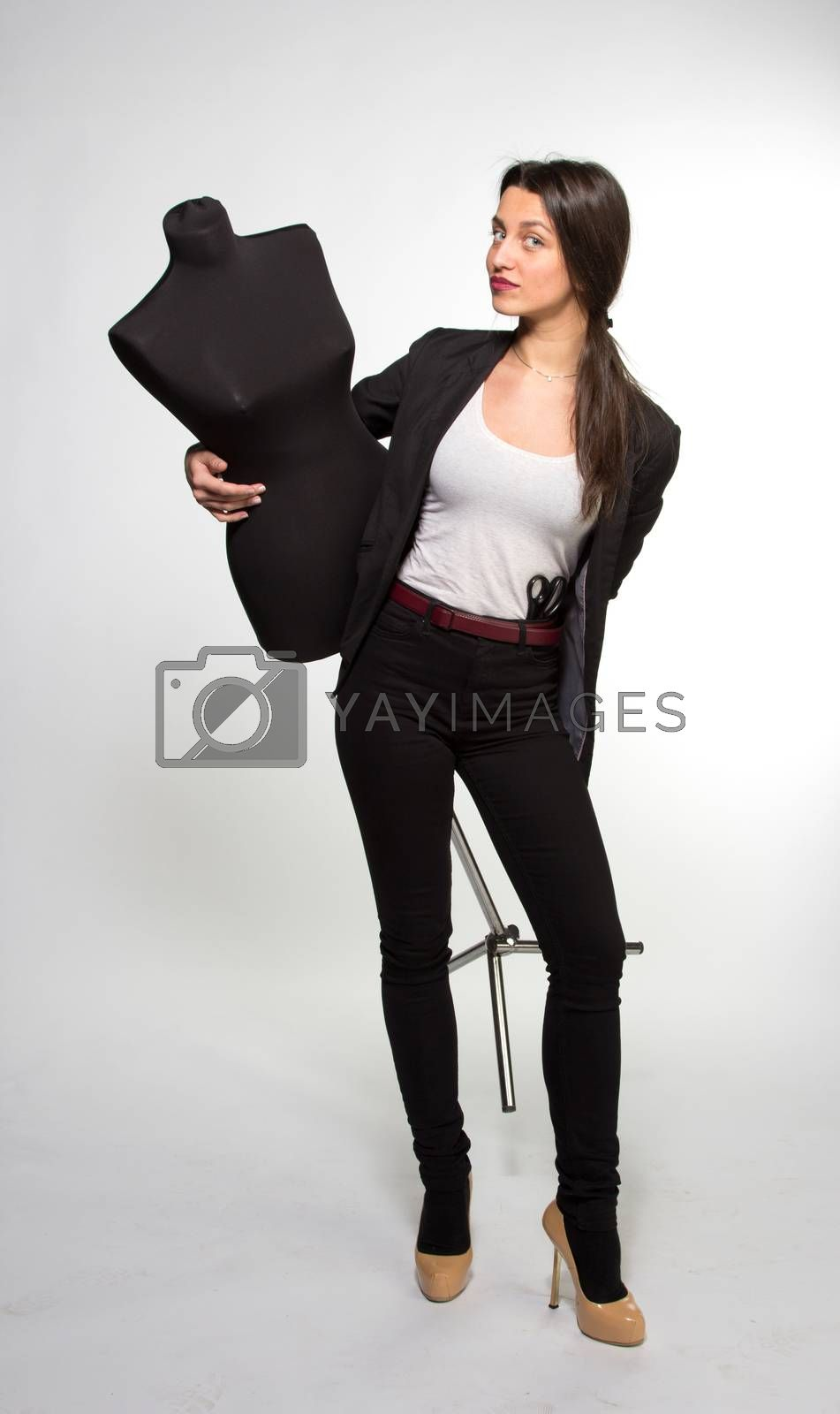 Woman tailor holding on Mannequin, isolated on white