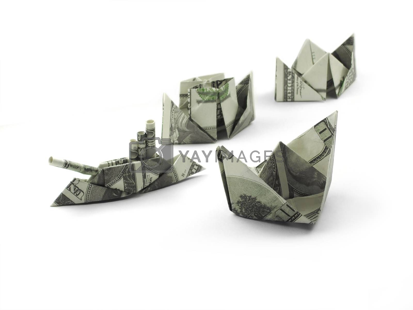 collection of origami ships of one hundred dollar banknotes