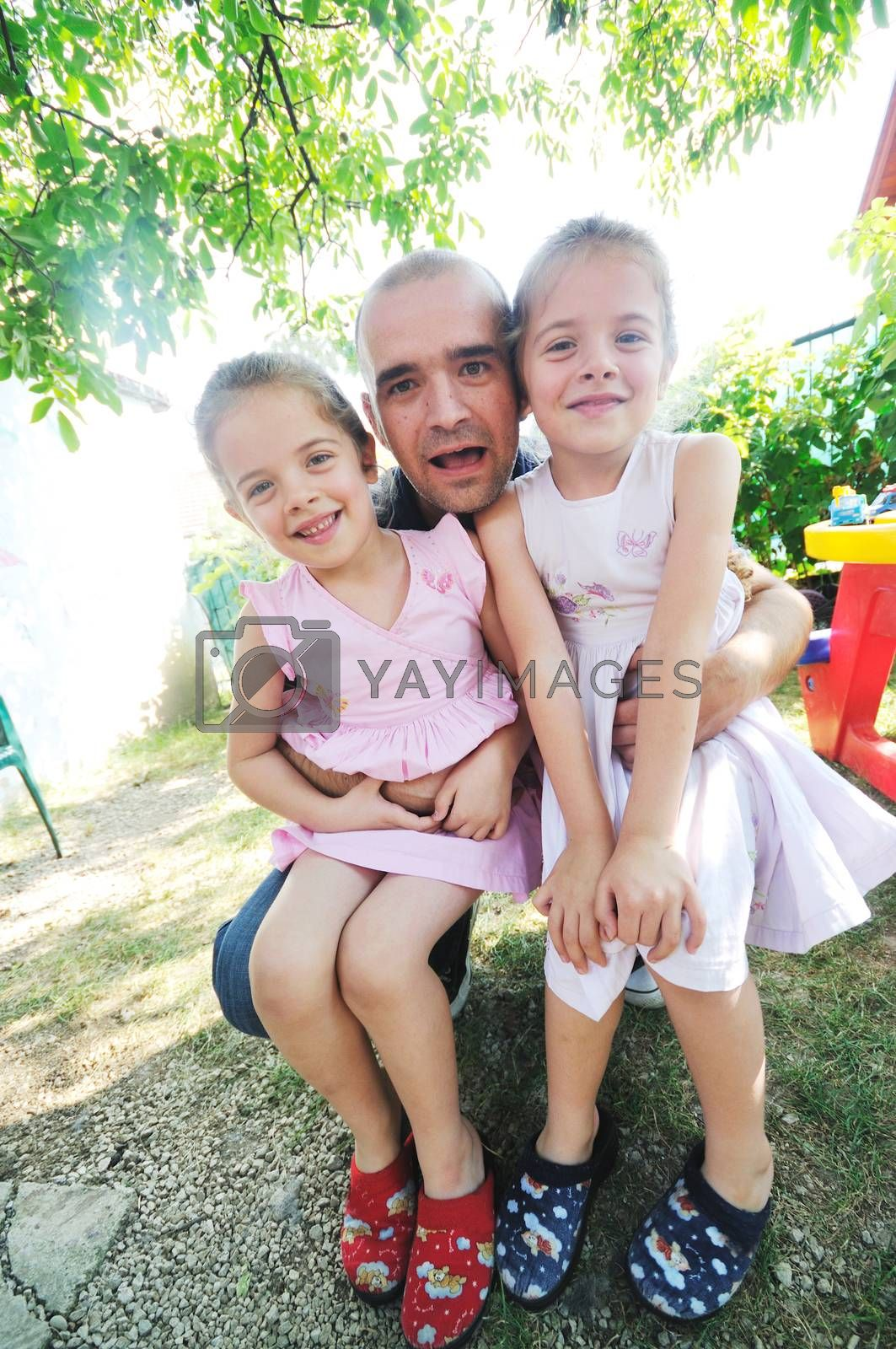 young peple group with young little twins girls outdoor
