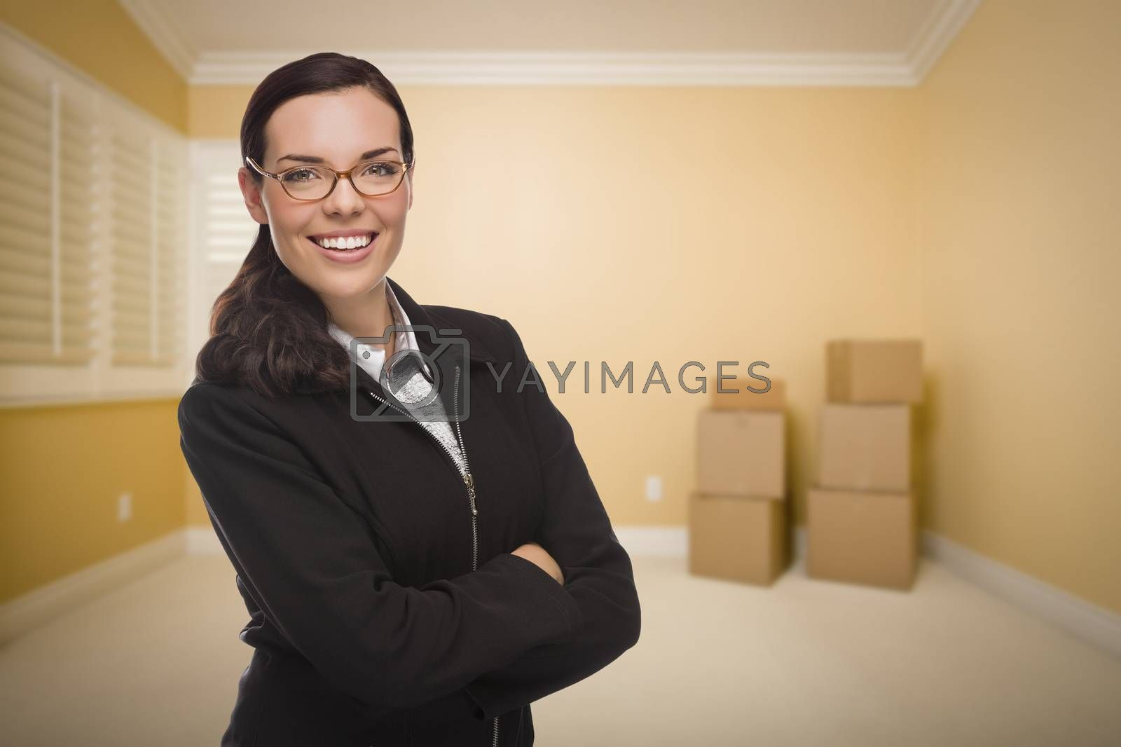 Attractive Confident Mixed Race Woman in Empty Room with Boxes.