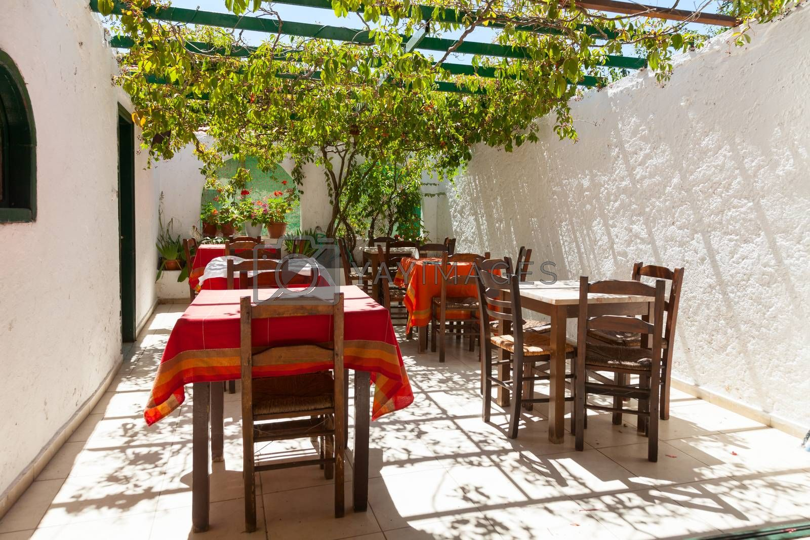 Tables with chairs at typical greek cafe