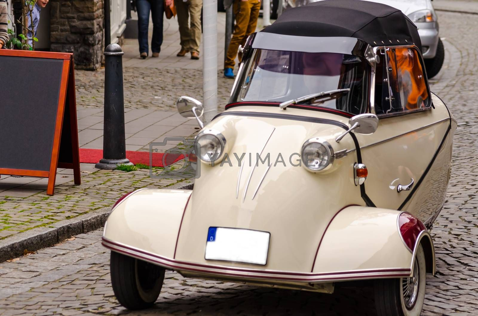 Essen Kettwig, Nrw, Germany - March 30, 2014: Essen Kettwig downtown, Messerschmitt cabin scooter on a city transit at a oldtimer rally.  Produced by the Messerschmitt company.  Designer of the vehicle was the engineer Fritz Fend.