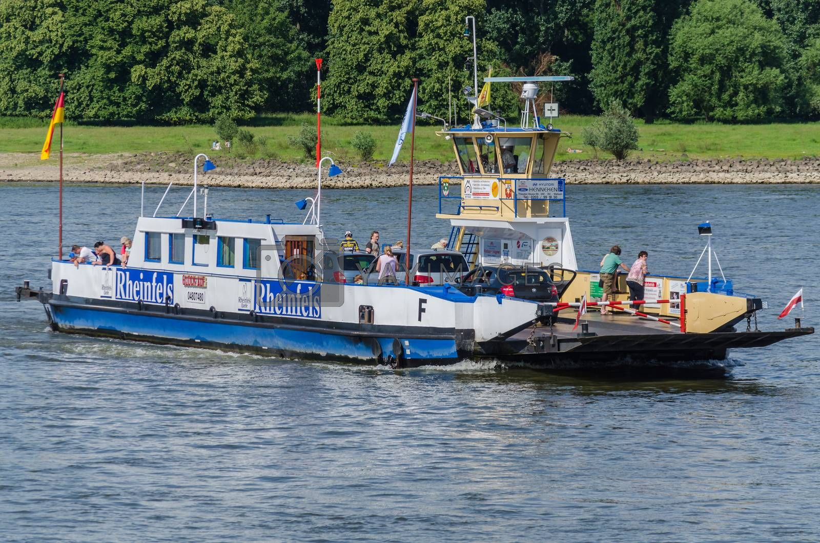 Orsoy, Nrw,  Germany - June 09, 2014:  Ferry City Orsoy on the Rhine. The ferry connects Orsoy in NRW, the city of Duisburg Walsum. Some passengers on the ship