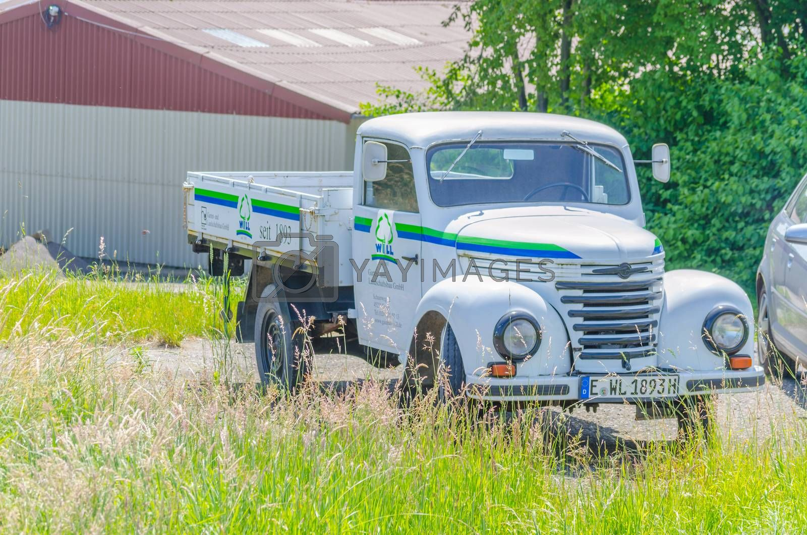 Essen, Nrw, Germany - June 13, 2014: In Essen way towards Mülheim Airport. Old truck parked on the street, to advertising. Oldtimer constructed from the year 1954 to 1961 in the former GDR in the VEB Barkas works Karl Marx Stadt.  This three-quarter-ton truck is the smallest of the former GDR have been.