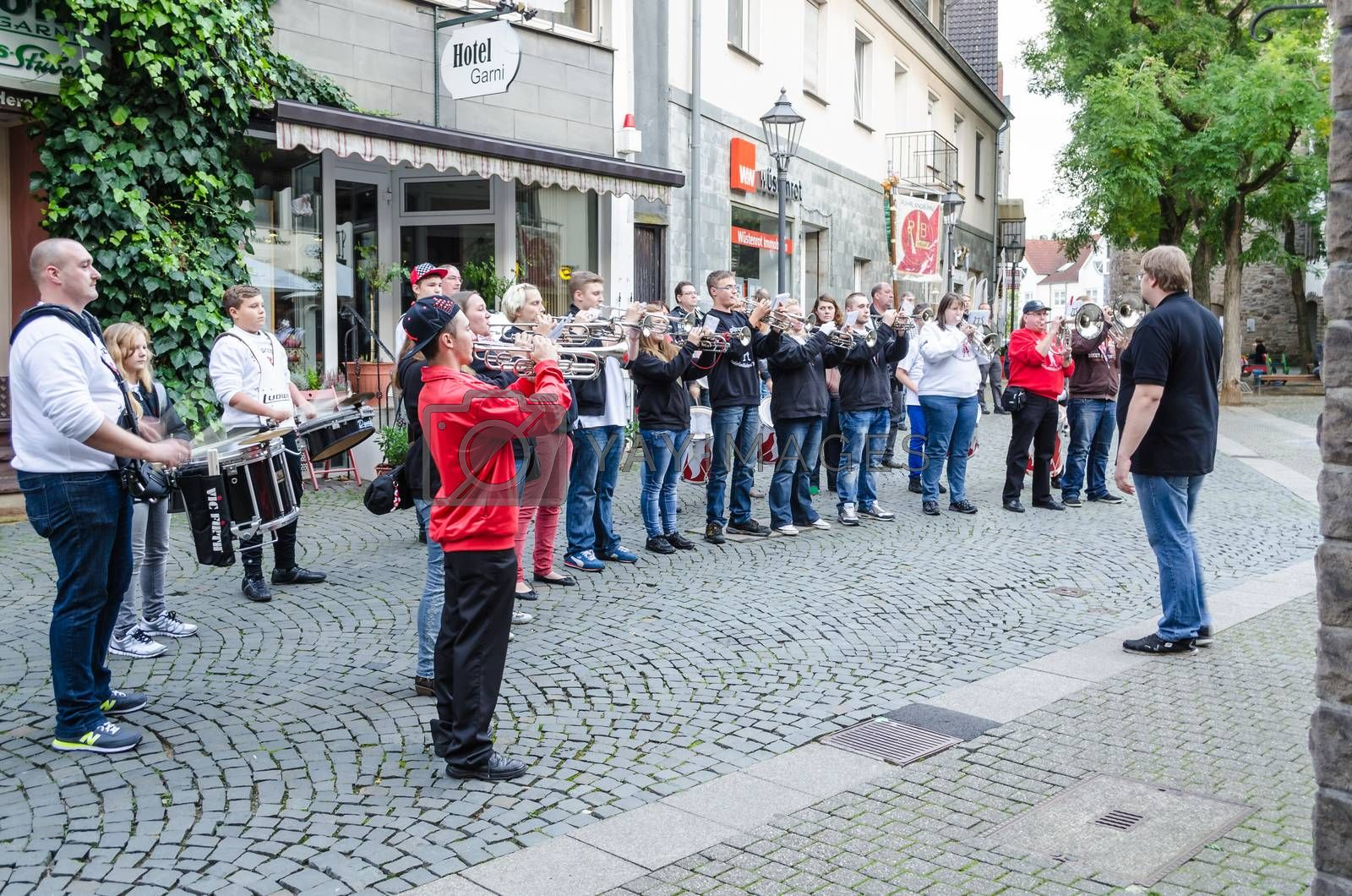 Hattingen old town, Nrw, Germany - October 10, 2014: Members of a marching band chapel to open a restaurant in the old town of Hattingen. In Vordergurnd the conductor.