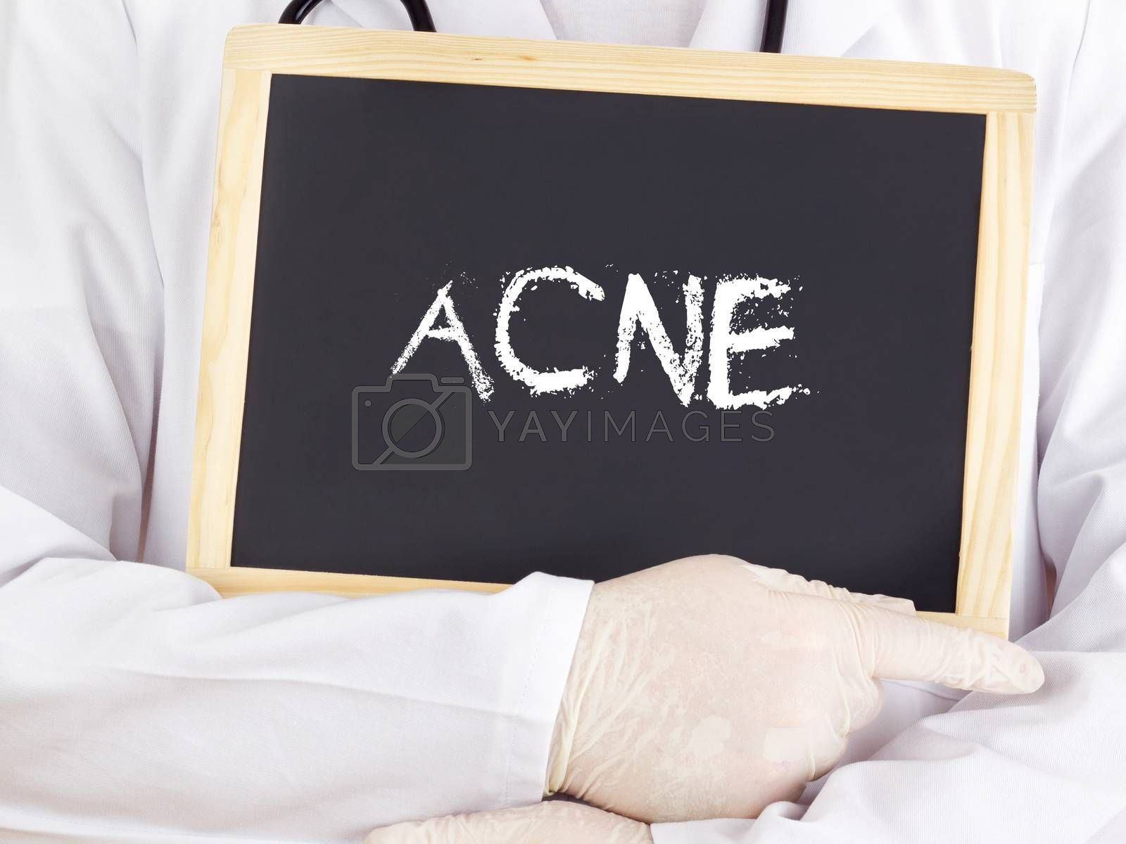 Royalty free image of Doctor shows information on blackboard: acne by gwolters