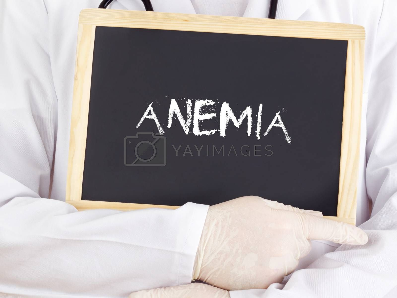 Royalty free image of Doctor shows information on blackboard: anemia by gwolters